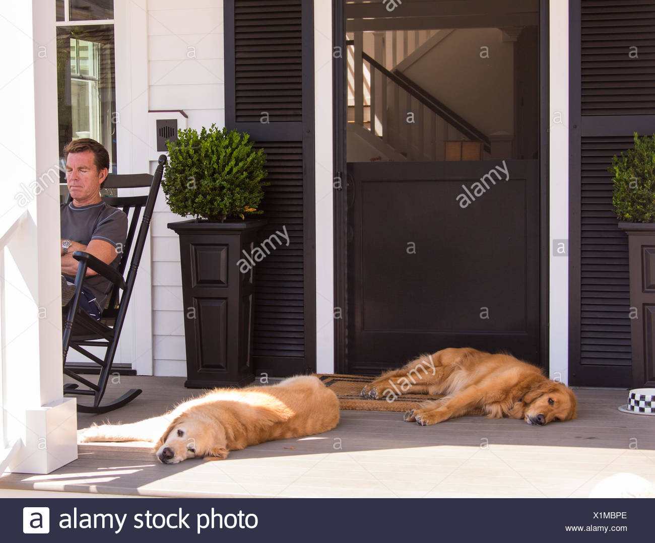 Relaxing on the patio - Stock Image