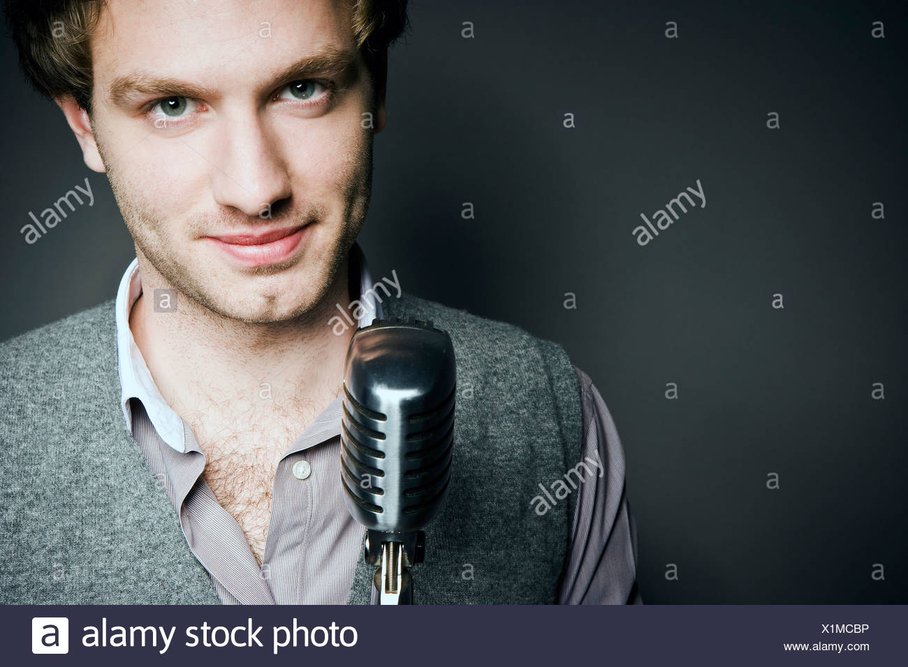 Confident man with mic - Stock Image