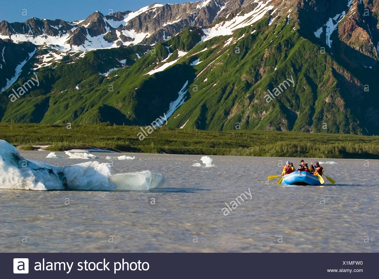 Rafting group paddles across Miles Lake to finish a 250-mile expedtion in the Copper River drainage Southcentral Alaska summer - Stock Image