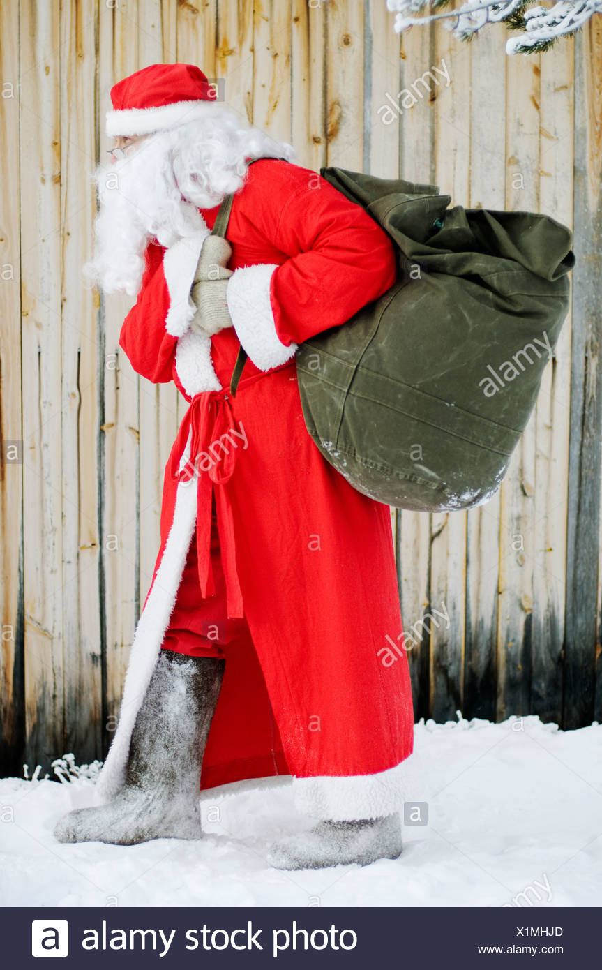Santa Claus carrying a sack Lapland Finland - Stock Image