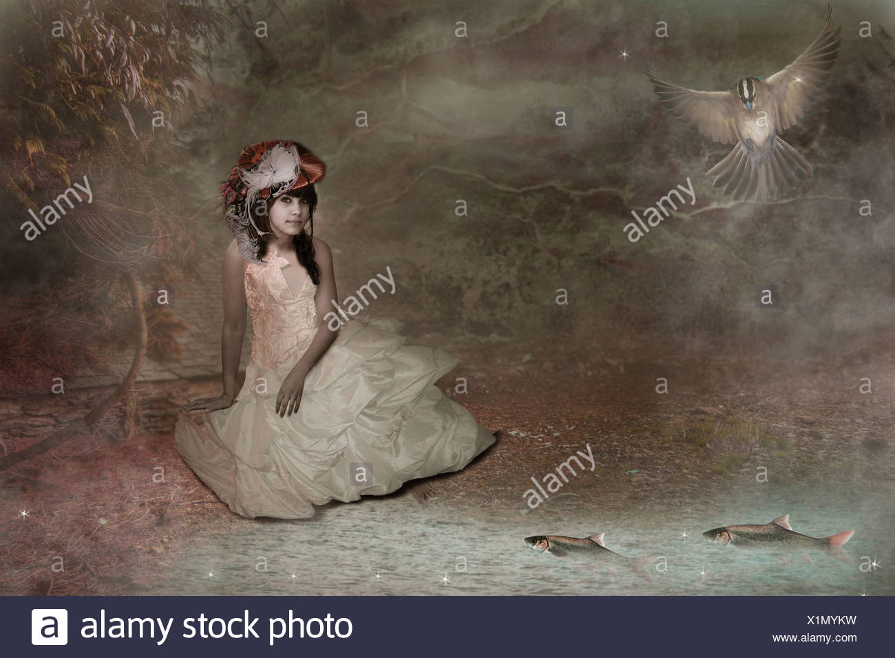 young woman sitting by a pond wearing old fashioned dress Stock Photo