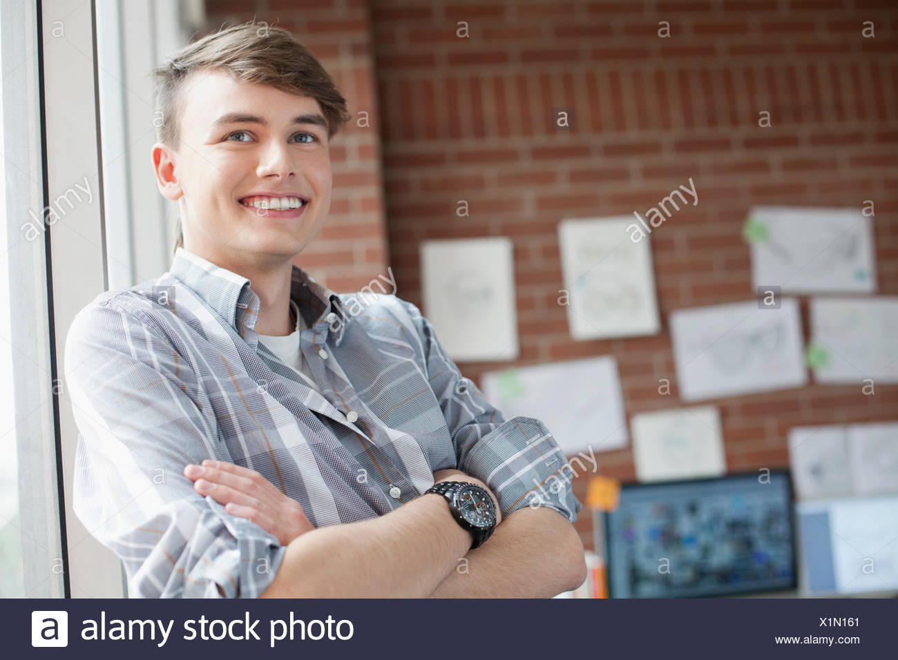 young male industrial designer in studio - Stock Image