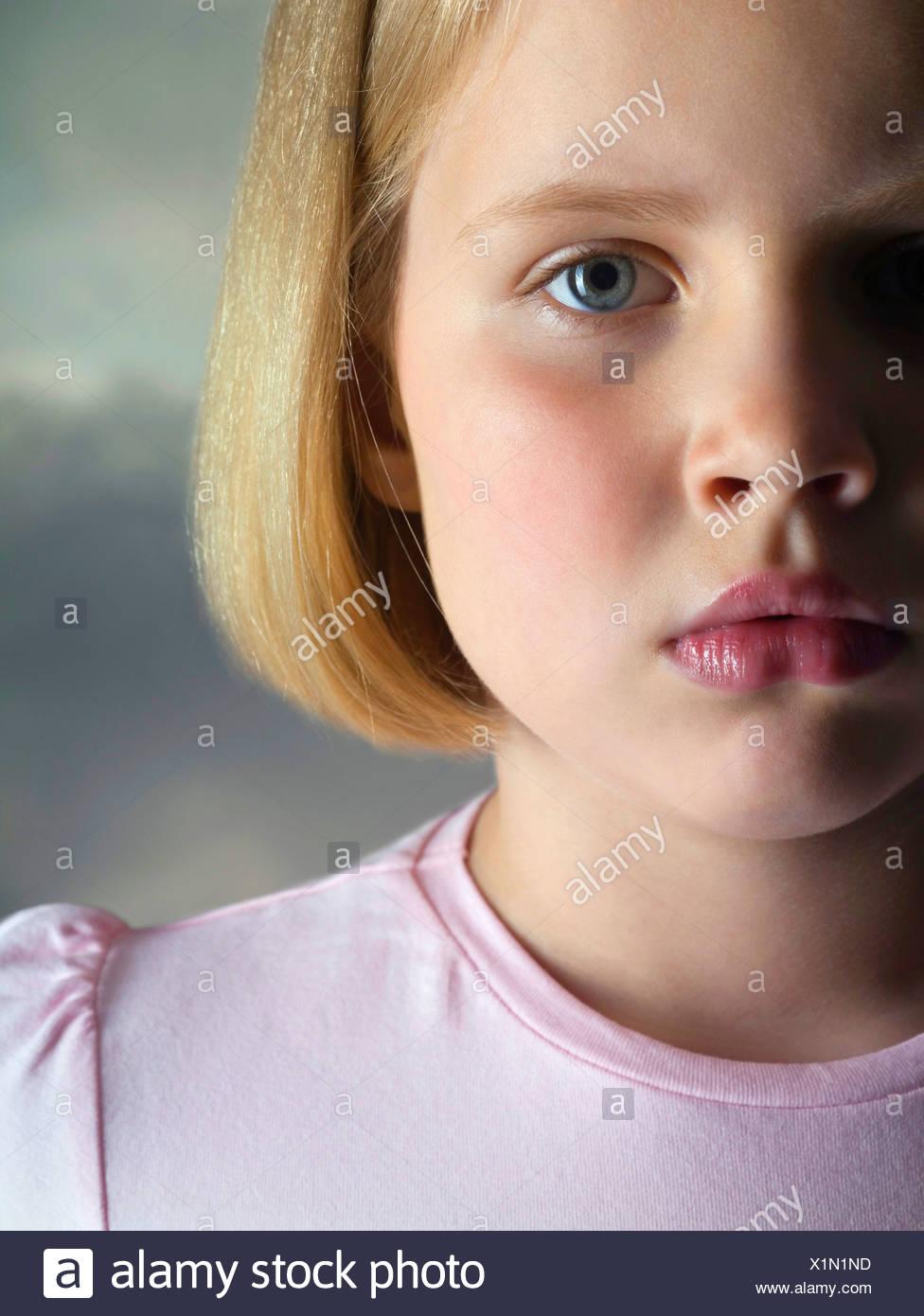Portrait a sad young girl, studio shot - Stock Image