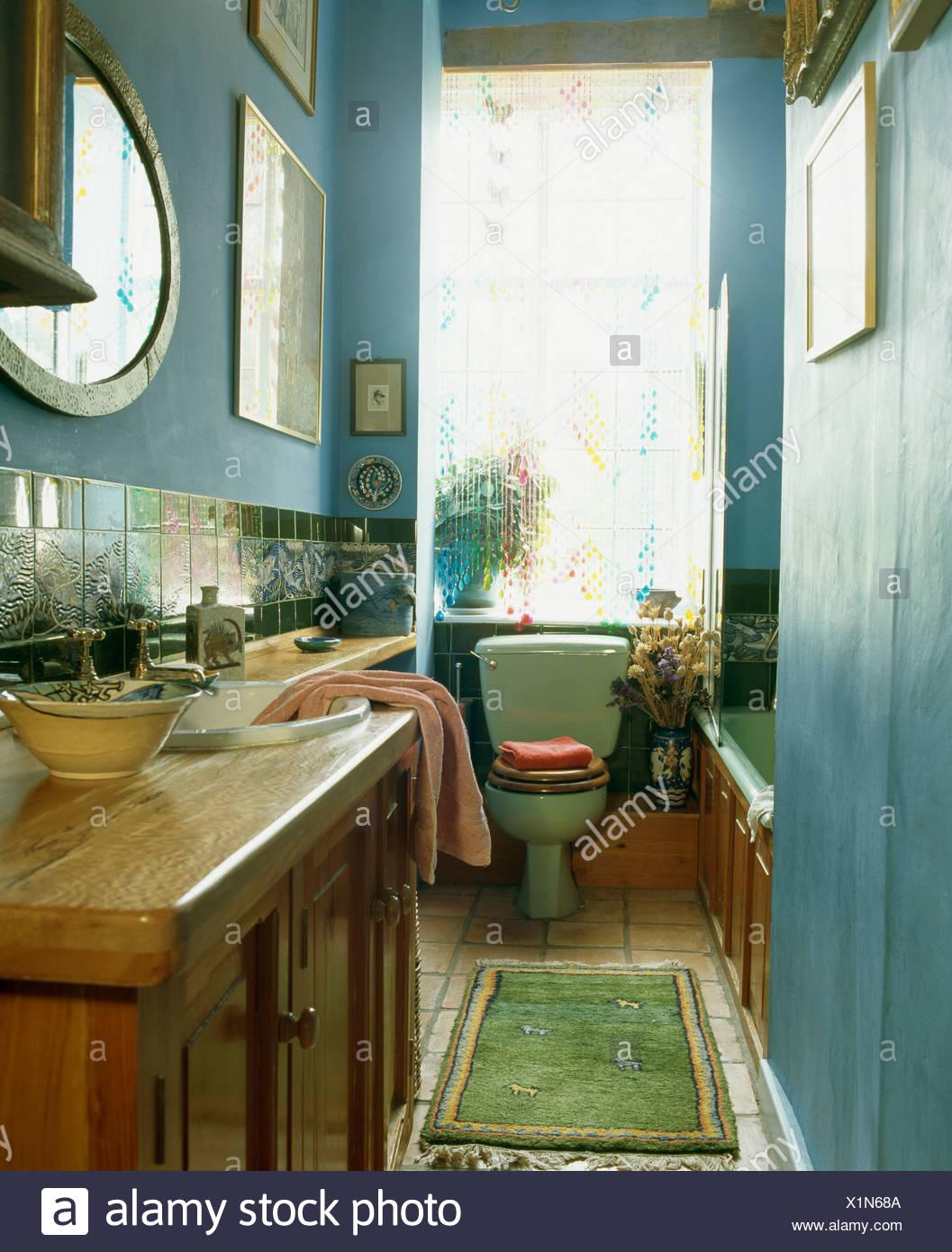 Old pine vanity unit in narrow blue bathroom with green rug ... Narrow Bathroom Design Tile Rug on mexican tile design rug, kitchen tile rug, ceramic tile rug, faucet design rug,