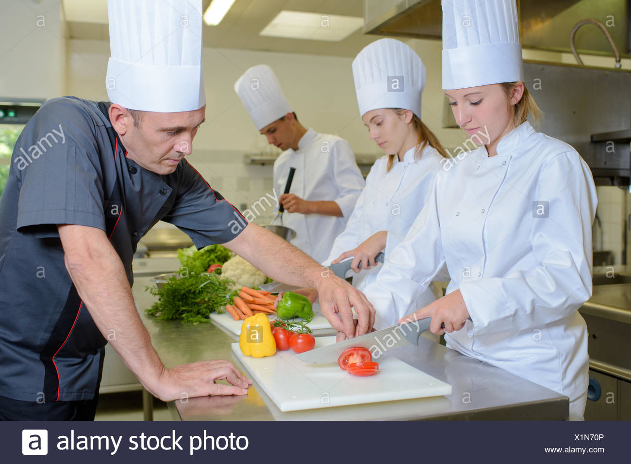technique in cutting a tomato - Stock Image