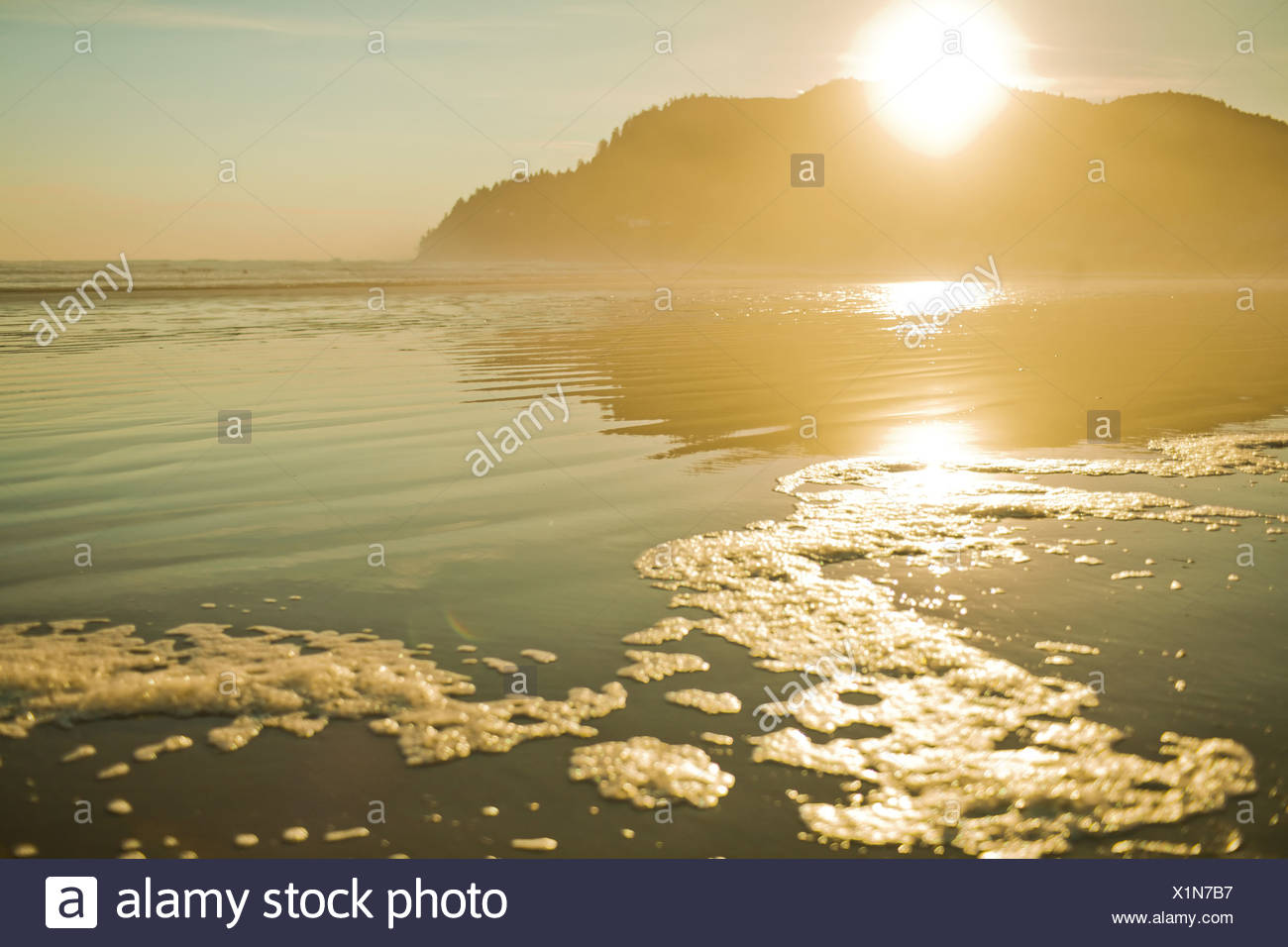 Sunset over mountain and ocean, Seaside, Oregon, USA - Stock Image