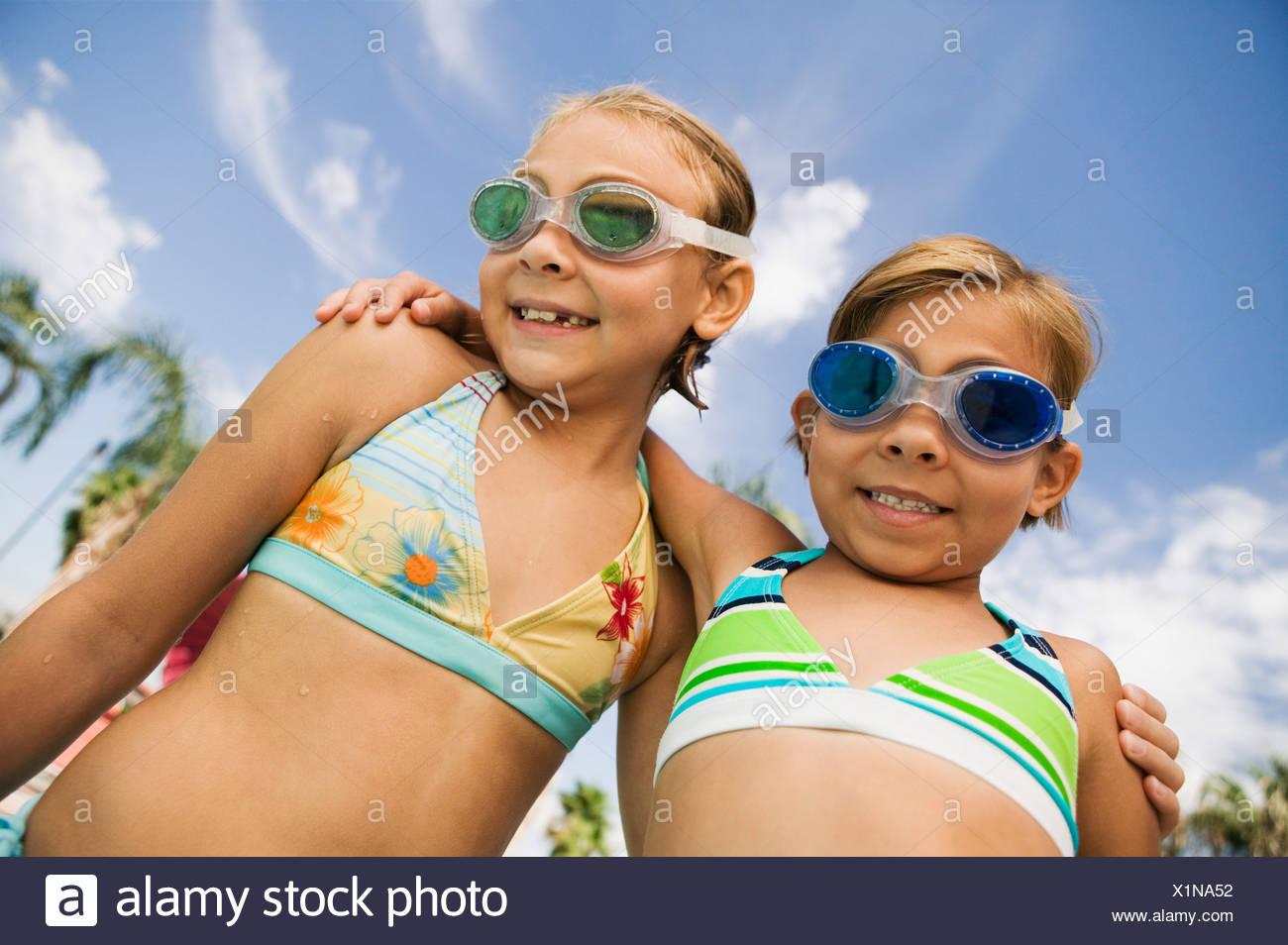 Two Girls (7-9) in swimwear, portrait. - Stock Image