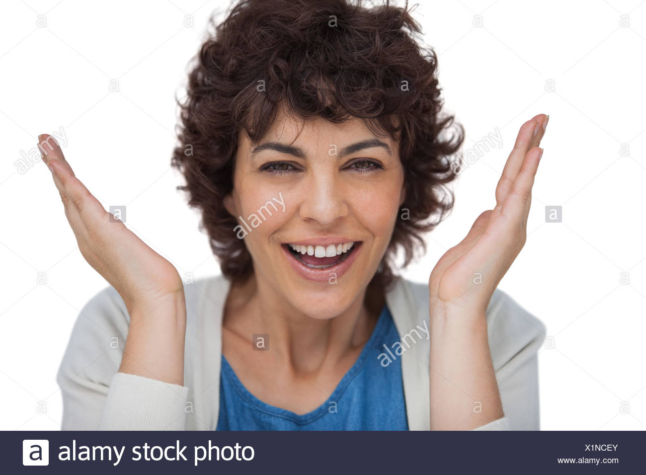 Shocked woman looking at the camera - Stock Image