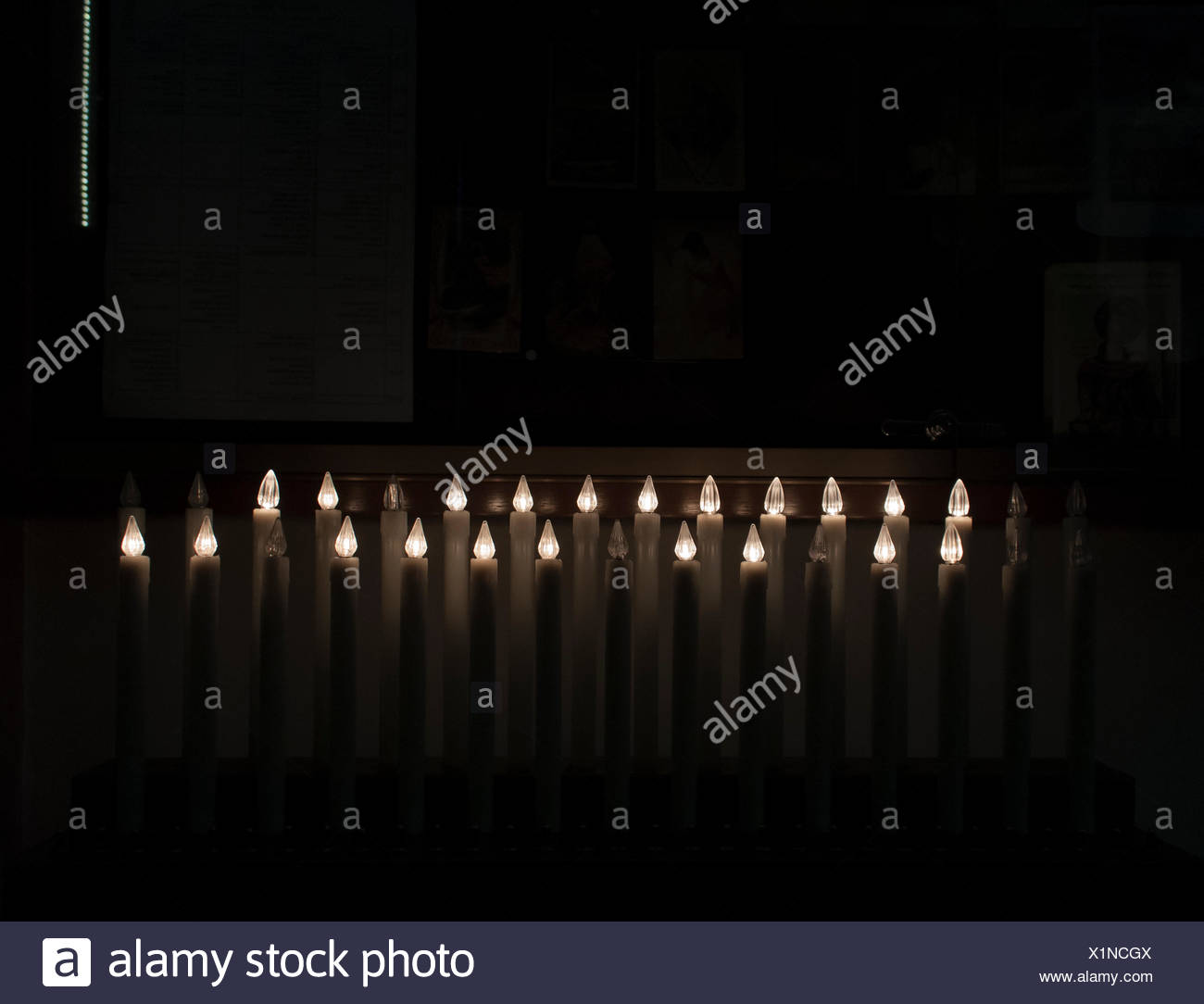 Electric Candles In Obscure Interior - Stock Image