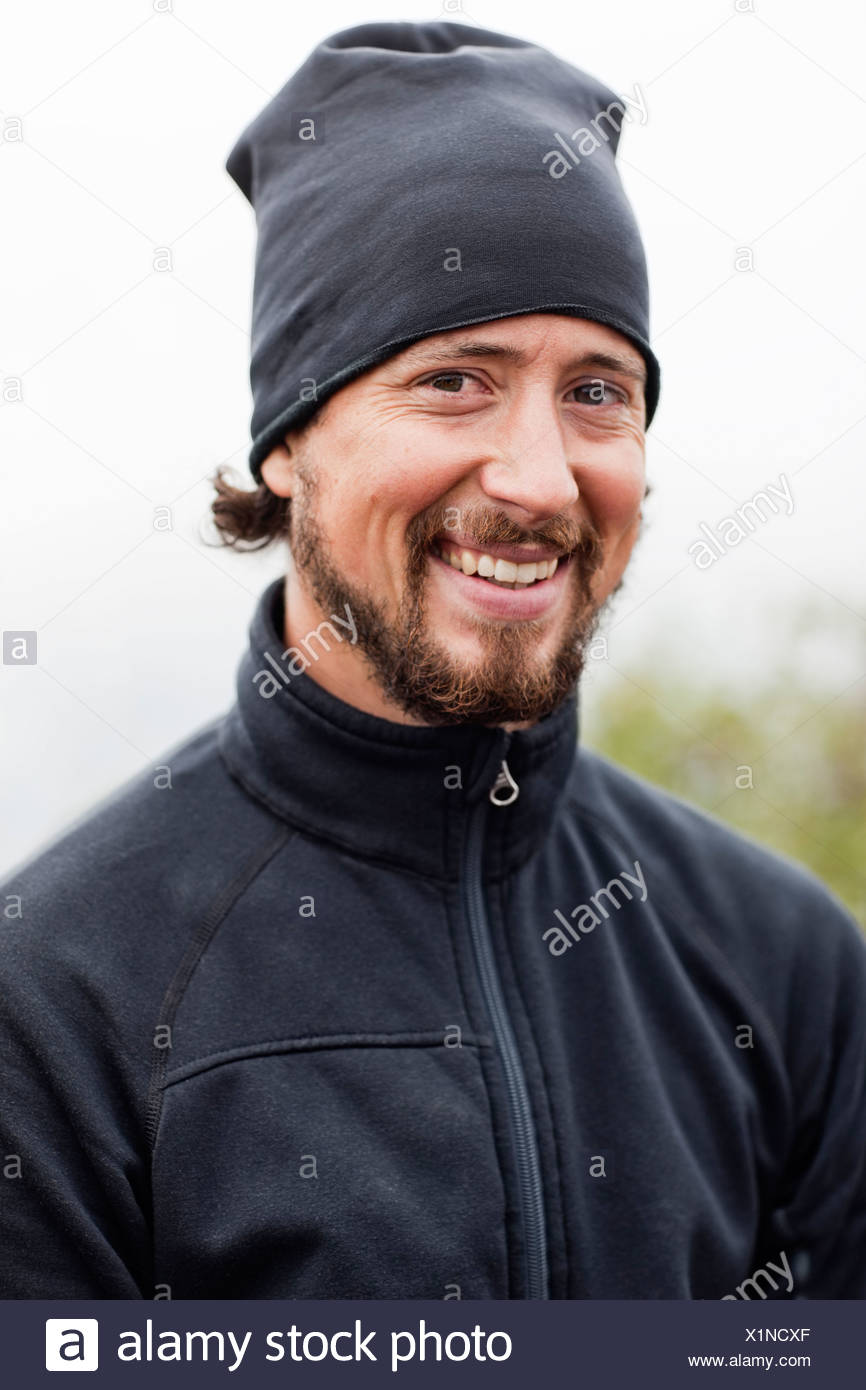 Portrait of smiling mid adult man - Stock Image