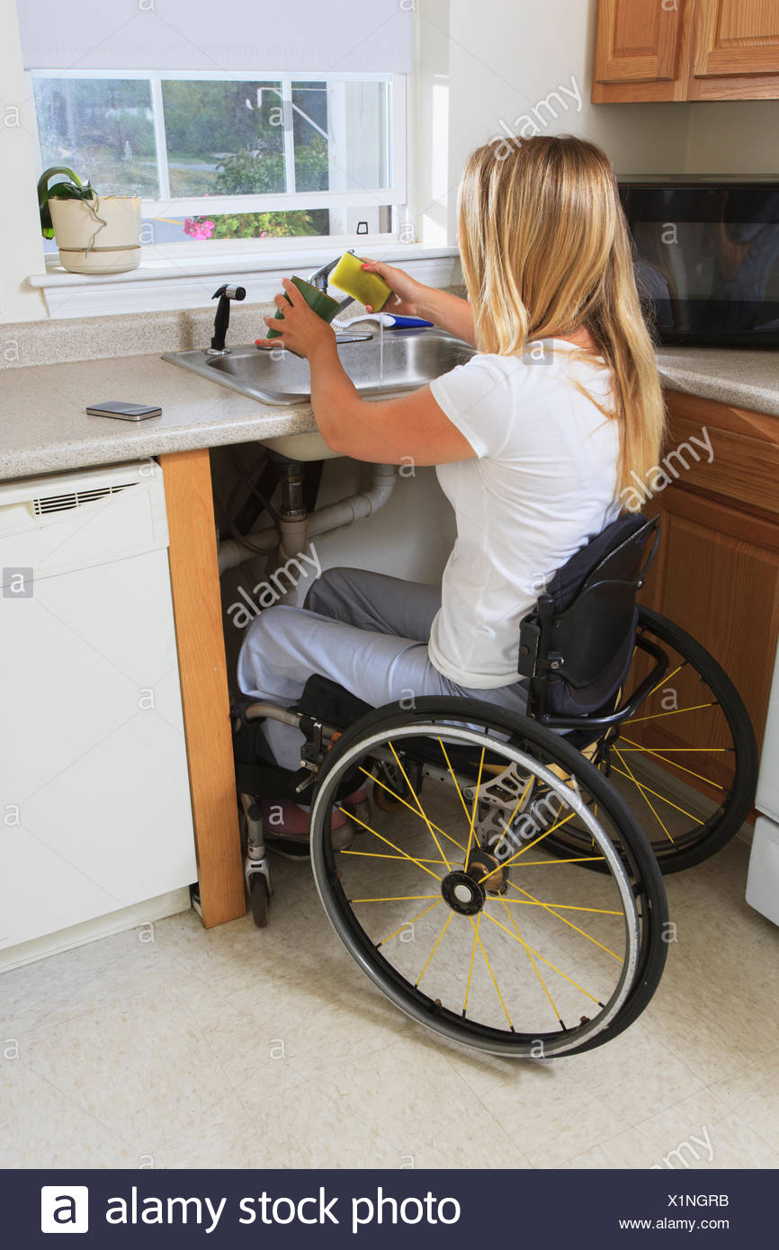 Woman With Spinal Cord Injury In Her Accessible Kitchen ...