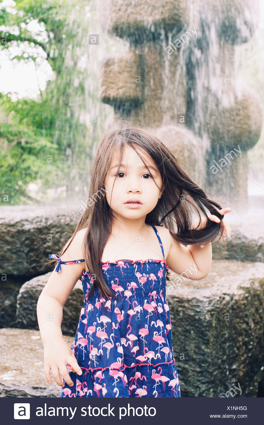 Little girl by water fountain, portrait - Stock Image