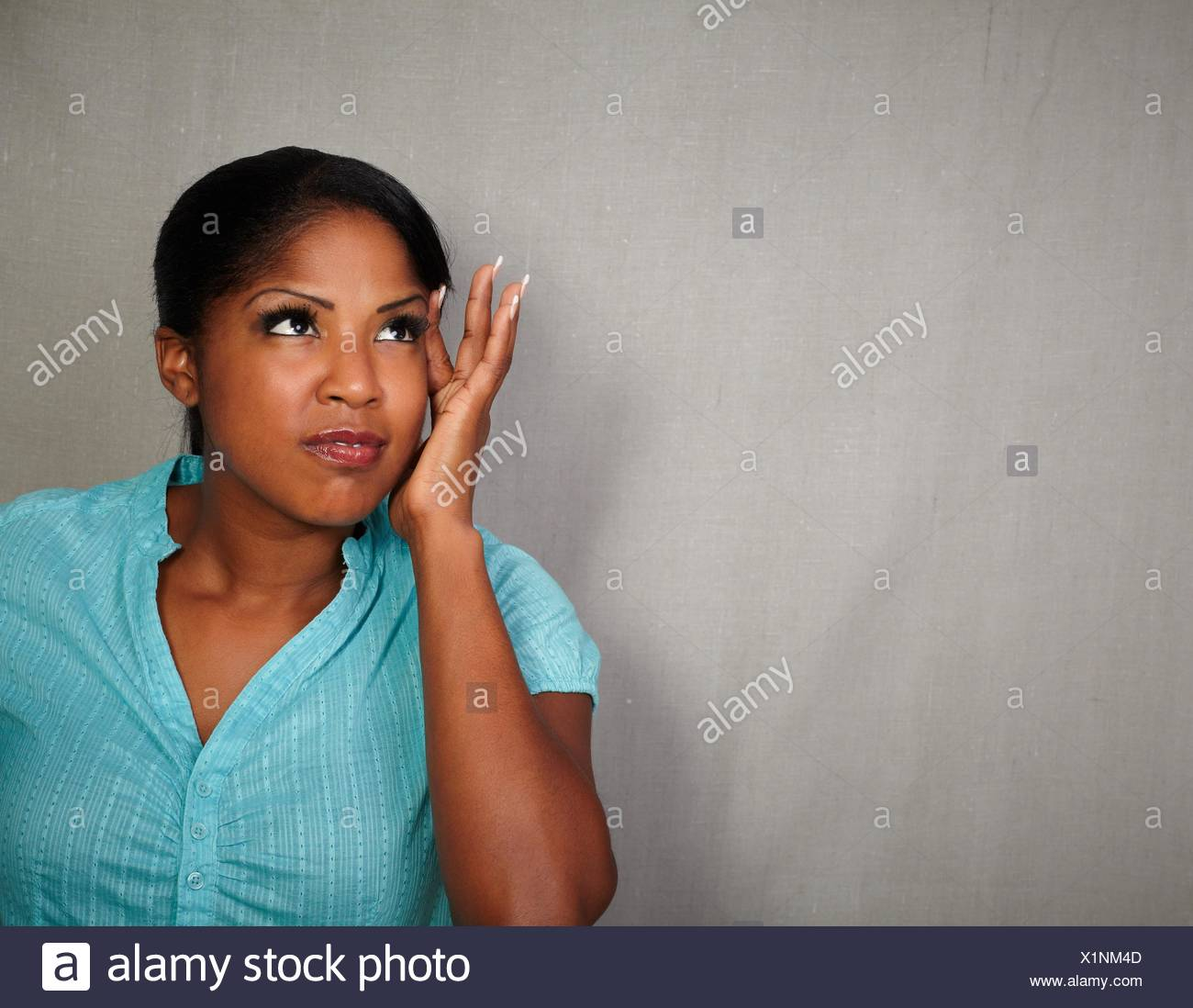 Charismatic young woman of african ethnicity having a headache - copy space. - Stock Image
