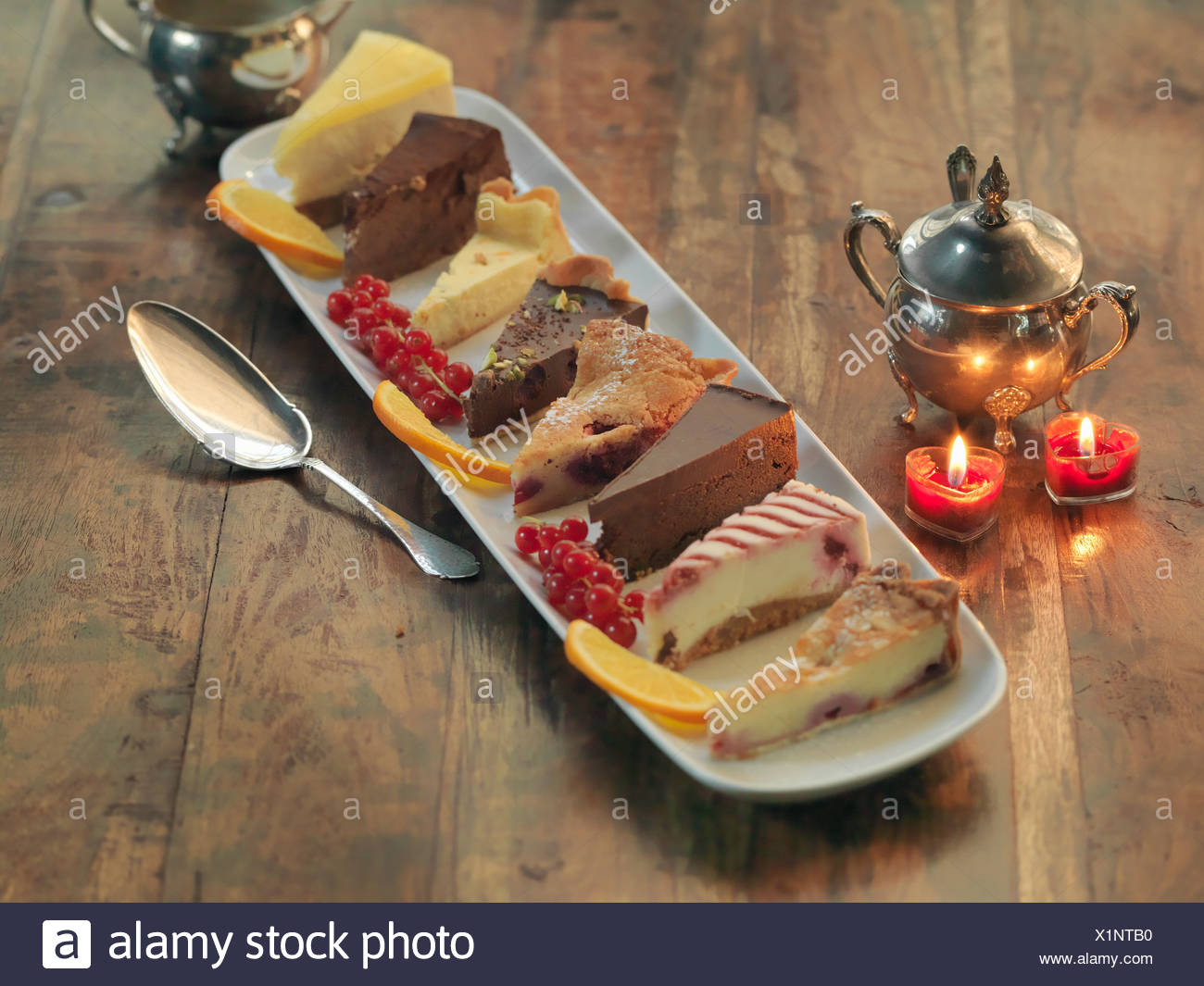 Mixed platter of cakes and tarts amongst festive decorations - Stock Image