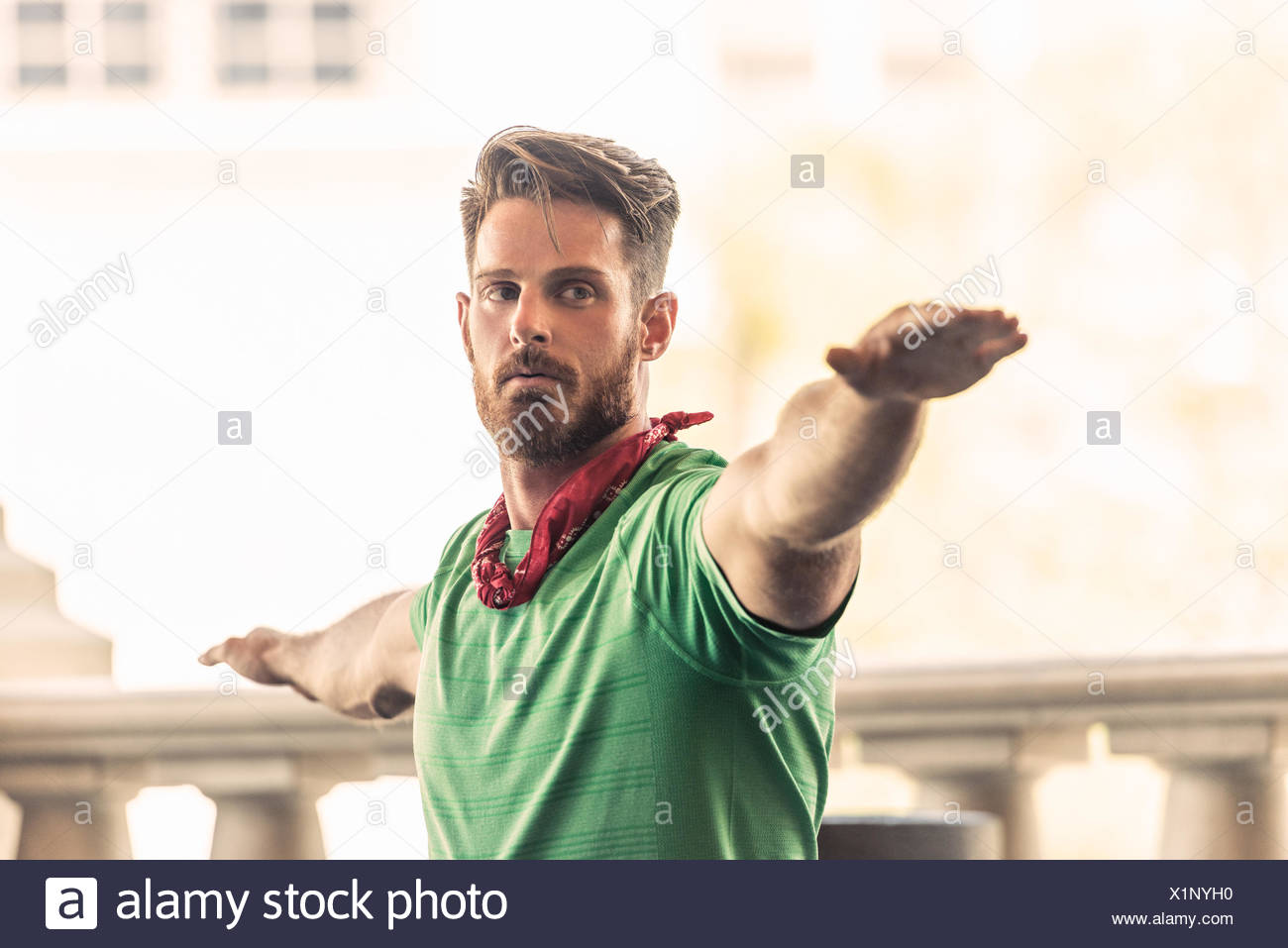 Young adult man in yoga position - Stock Image