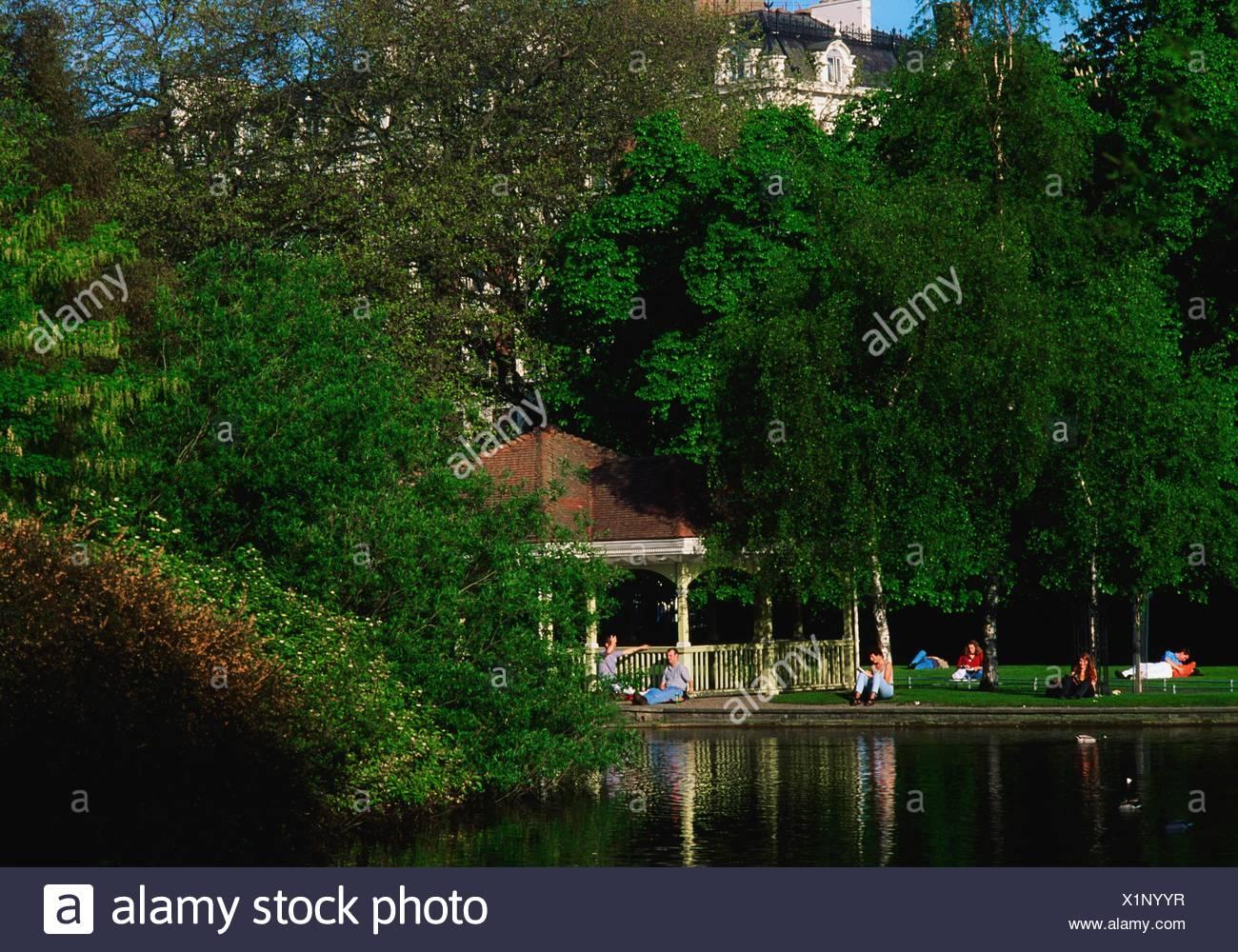 St Stephen's Green, Dublin, Co Dublin, Ireland; People Sitting In One Of Dublin's Public Parks - Stock Image