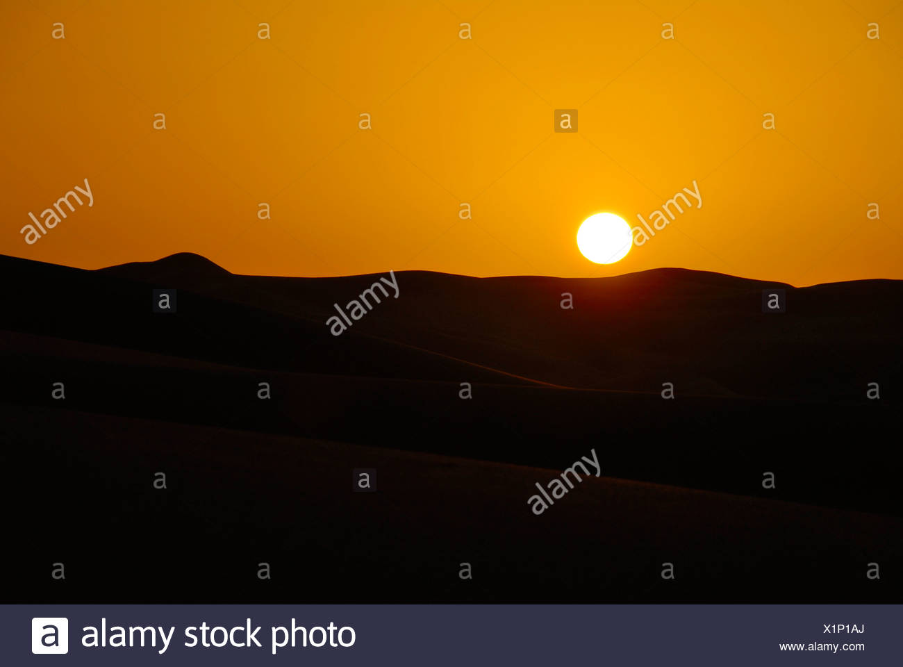 Orange sunrise in the desert Mandara Libya - Stock Image
