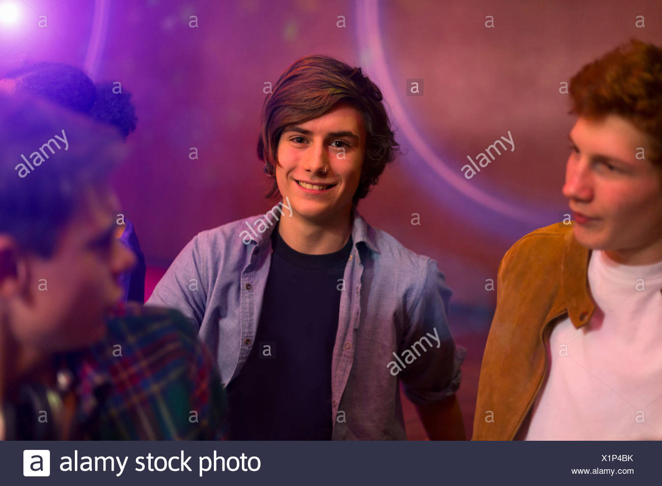Teenage boys standing at party - Stock Image