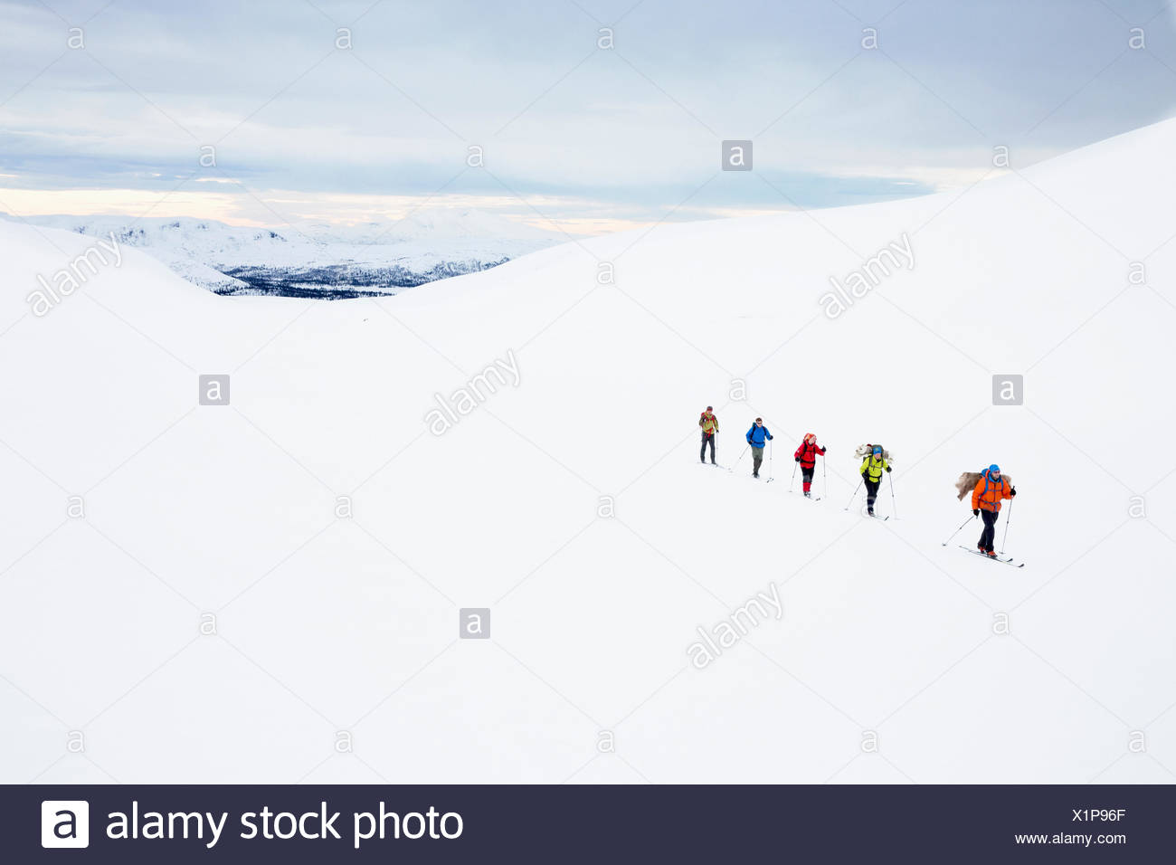 People skiing at sunset - Stock Image