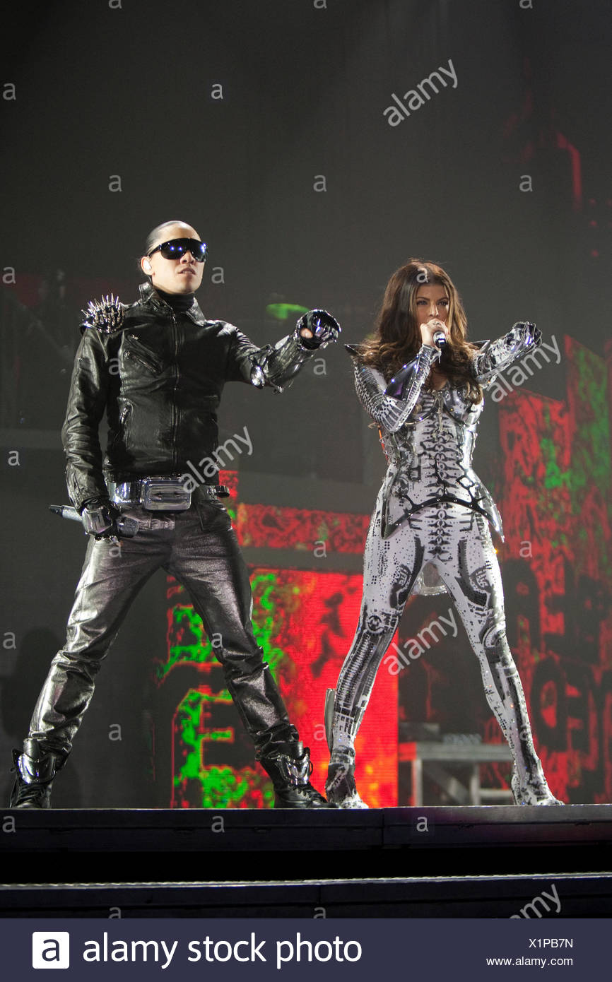 Singers Stacy Ann Ferguson, Fergie, and Jaime Luis Gomez of the U.S. Hip-Hop band The Black Eyed Peas live at the Hallenstadion - Stock Image