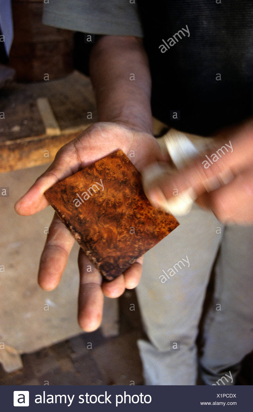 Man polishing a thuya root piece, marquetry at Essaouira, Morocco, North Africa - Stock Image