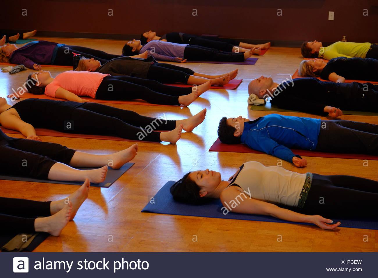 yoga students in savasana or corpse pose stock photo 276473313 alamy