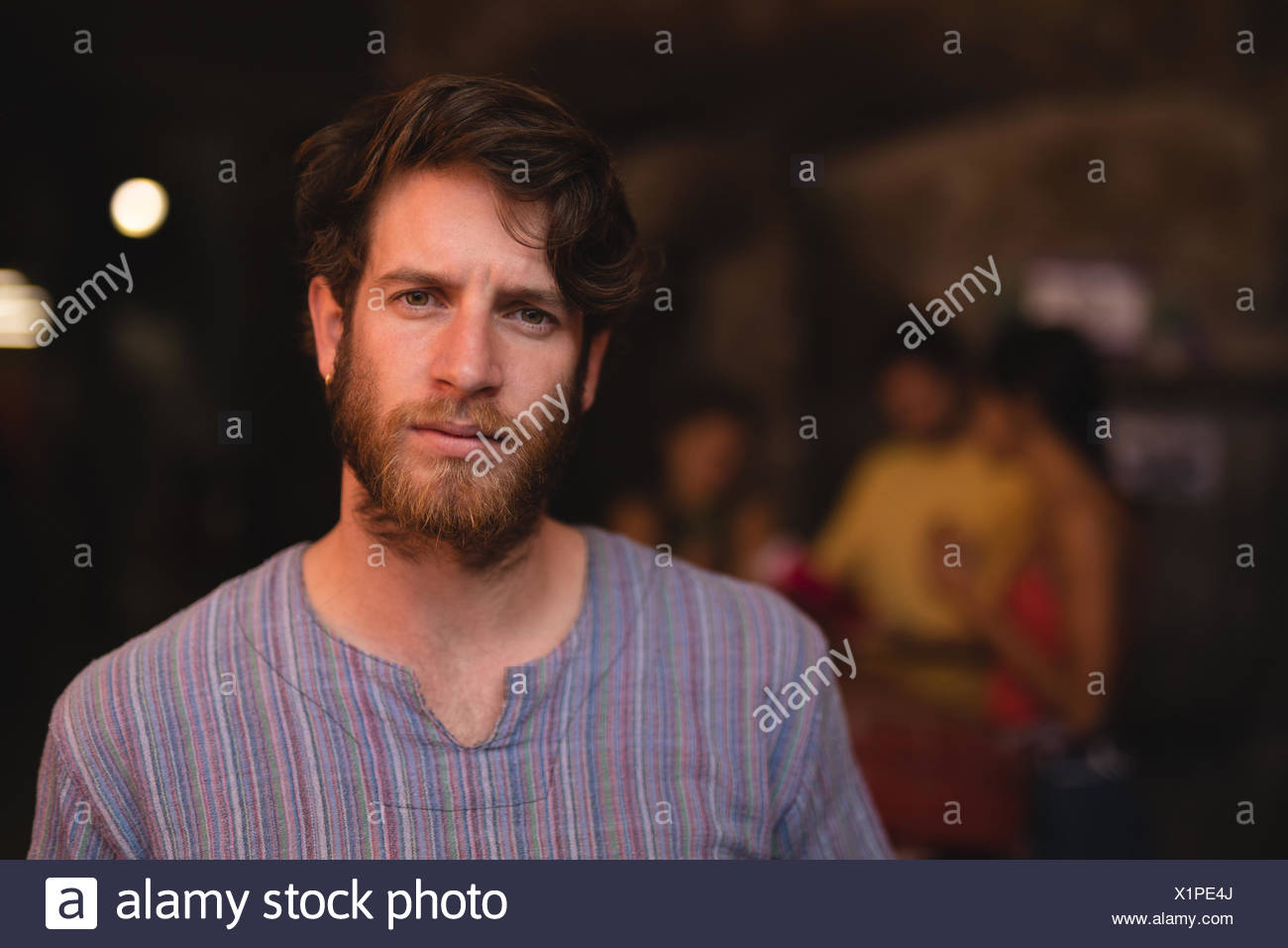 Portrait of confident male athlete standing in gym Stock Photo