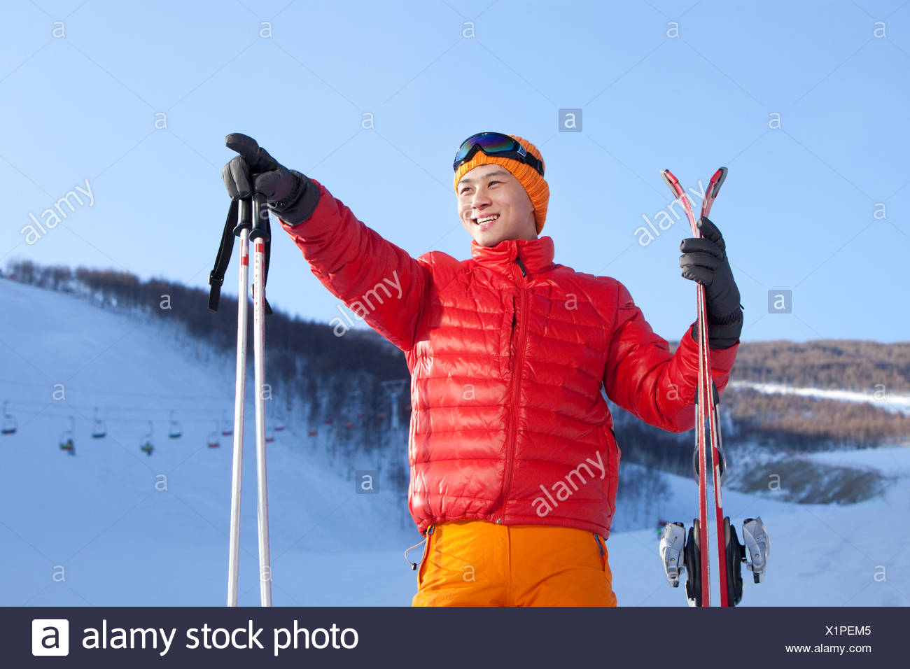 Young man in ski resort - Stock Image