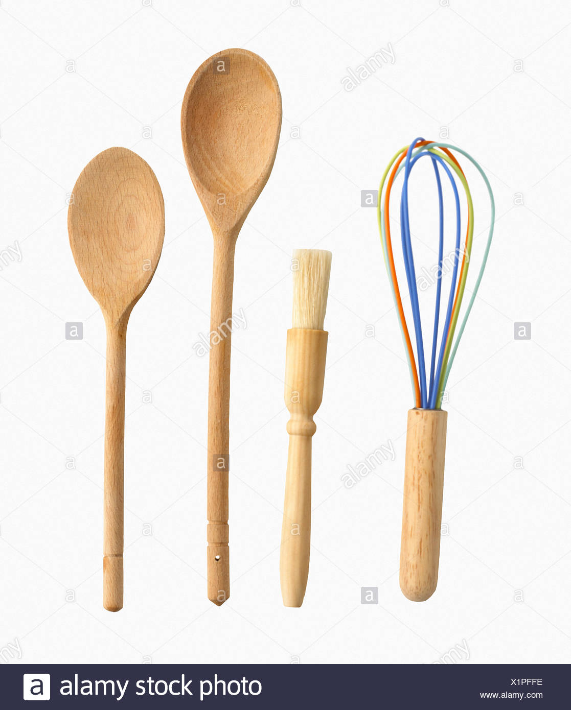 Whisk, pastry brush, wooden spoons - Stock Image