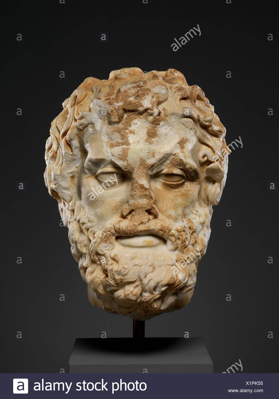 Marble head of a bearded man. Period: Imperial; Date: 2nd century A.D; Culture: Roman; Medium: Marble; Dimensions: H. 12 3/16 in. (31 cm); - Stock Image