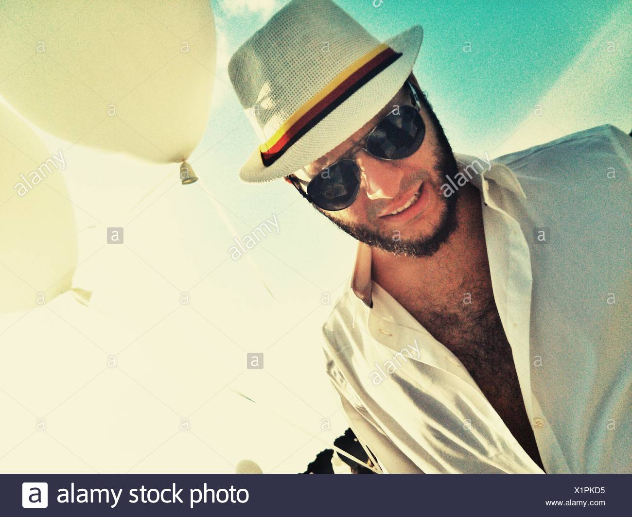 Fashionable Man Wearing Sunglasses And Hat - Stock Image