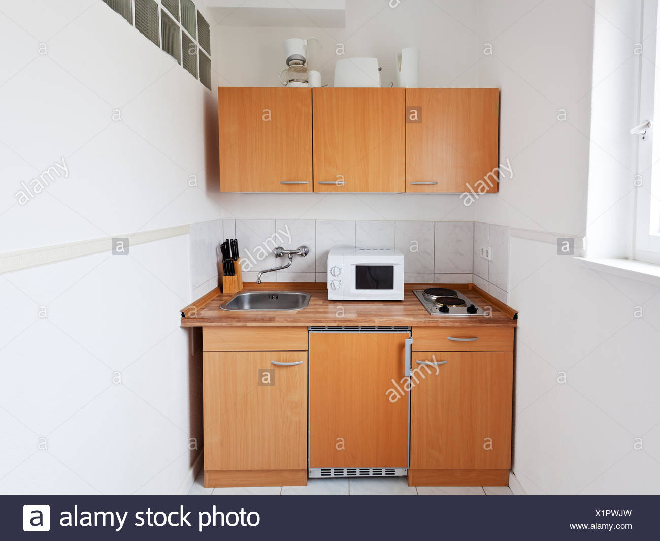 Small kitchen with furniture set and kitchen equipment