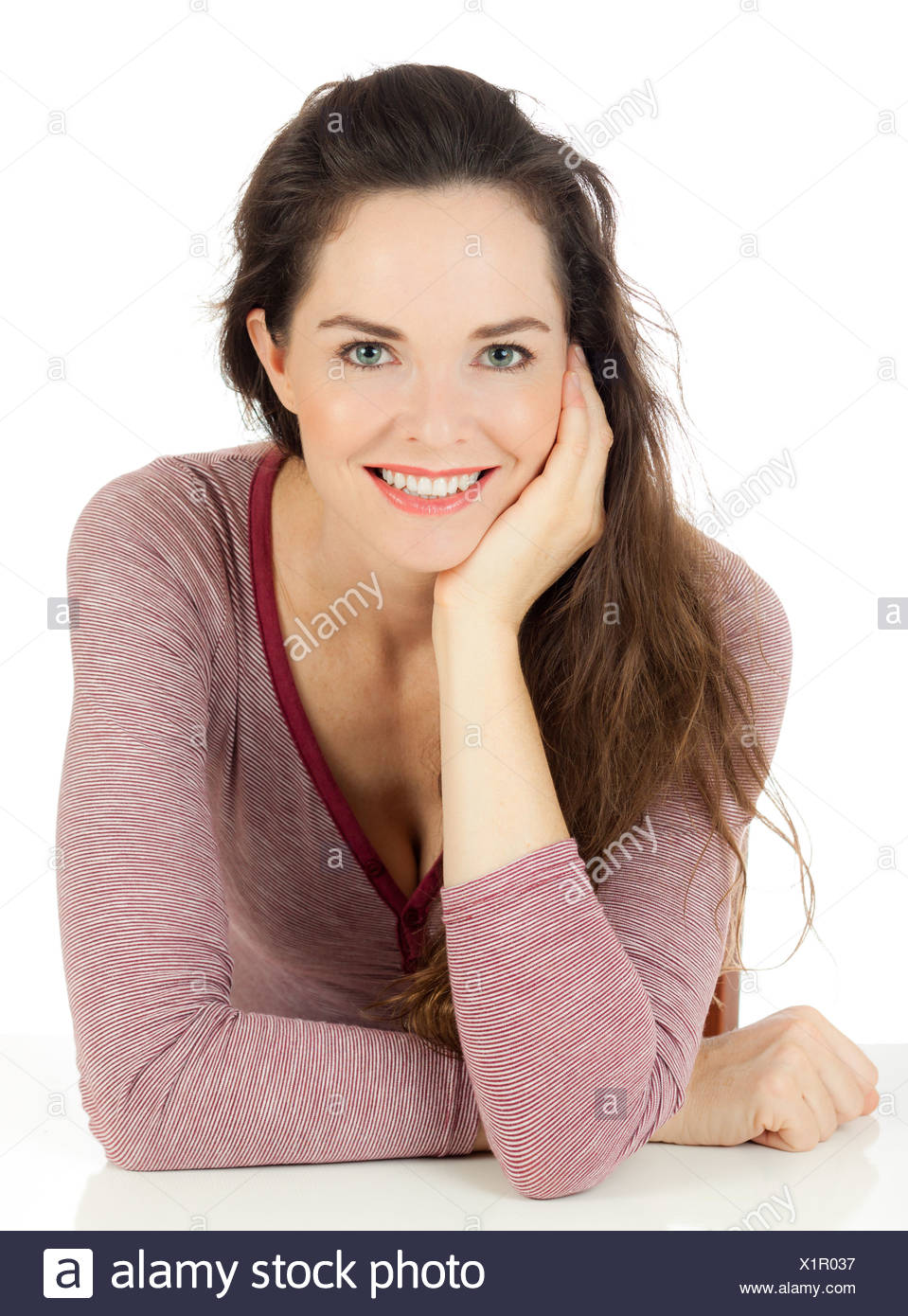 Isolated portrait of a relaxed and smiling young woman. - Stock Image