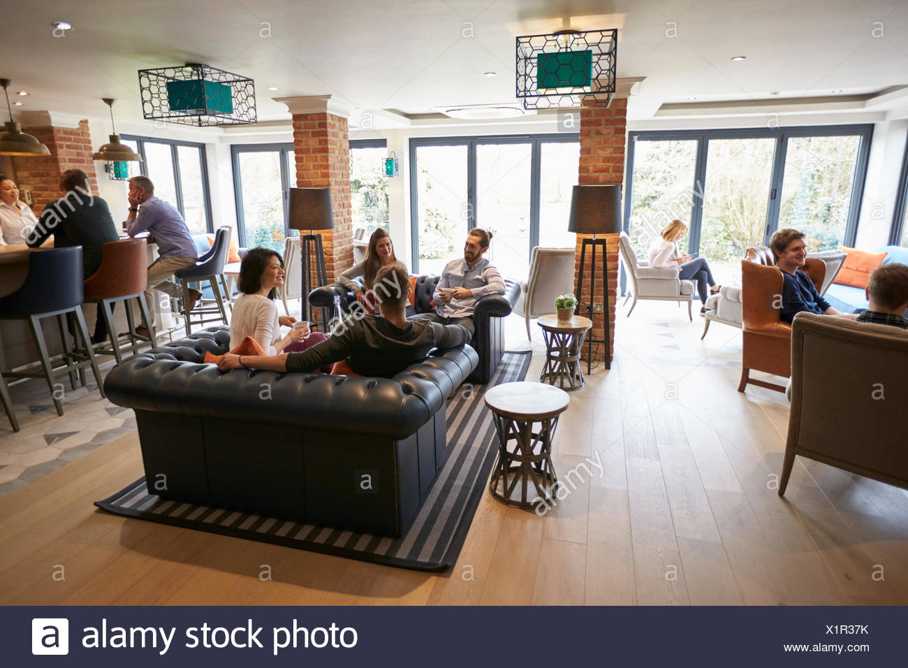 Charmant Busy Reception Area Of Modern Boutique Hotel With Guests   Stock Image