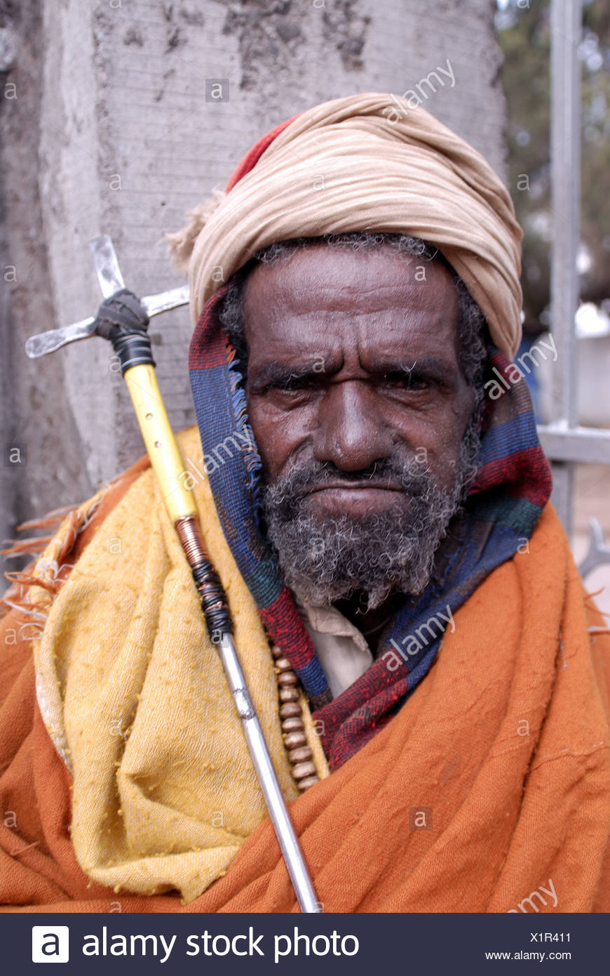 Ethiopia Lalibela pilgrims seriously portrait East-Africa people man old creditors headgear prayer-stick cross belief religion - Stock Image
