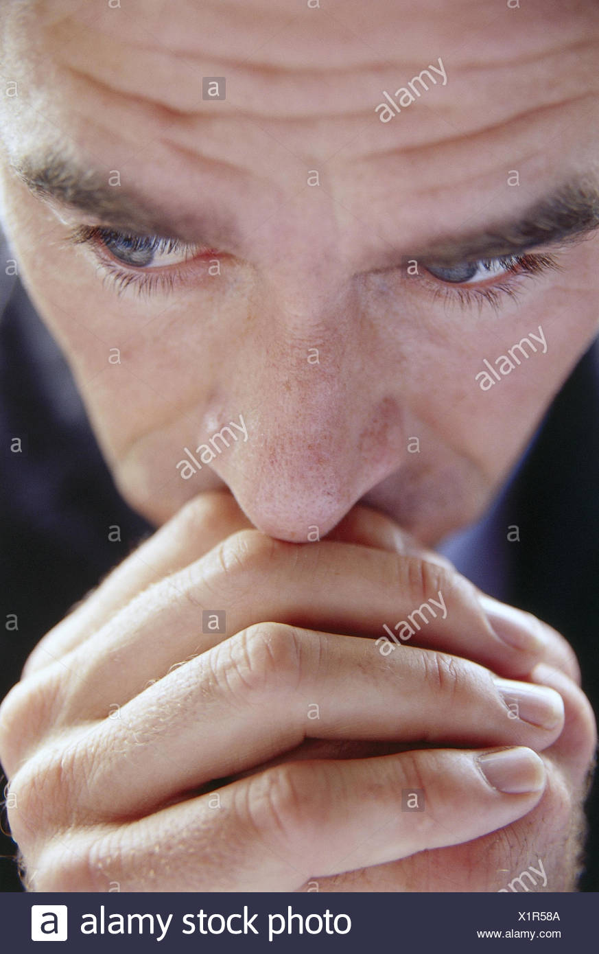 Man, dealts with, gesture, portrait, inside, pray, prayer, hands, rest, quietly, concentrates, concentration, desperately, brood, there think, thoughtful, worries, worried - Stock Image