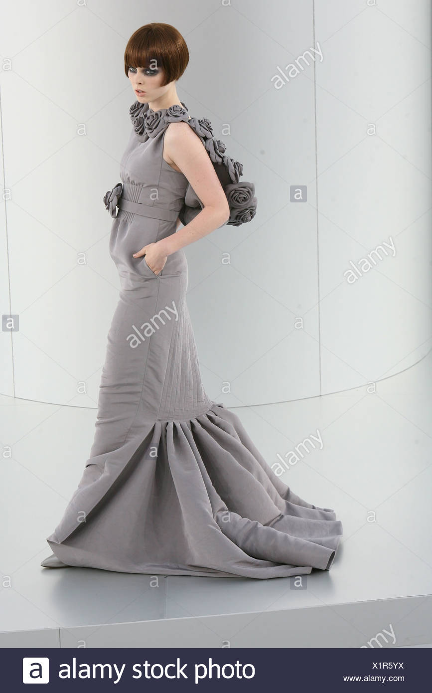 Chanel Prive Paris Haute Couture Autumn Winter Model Wearing A Flolength Grey Fishtail Dress Fabric Flower Hood And Belt Stock Photo Alamy