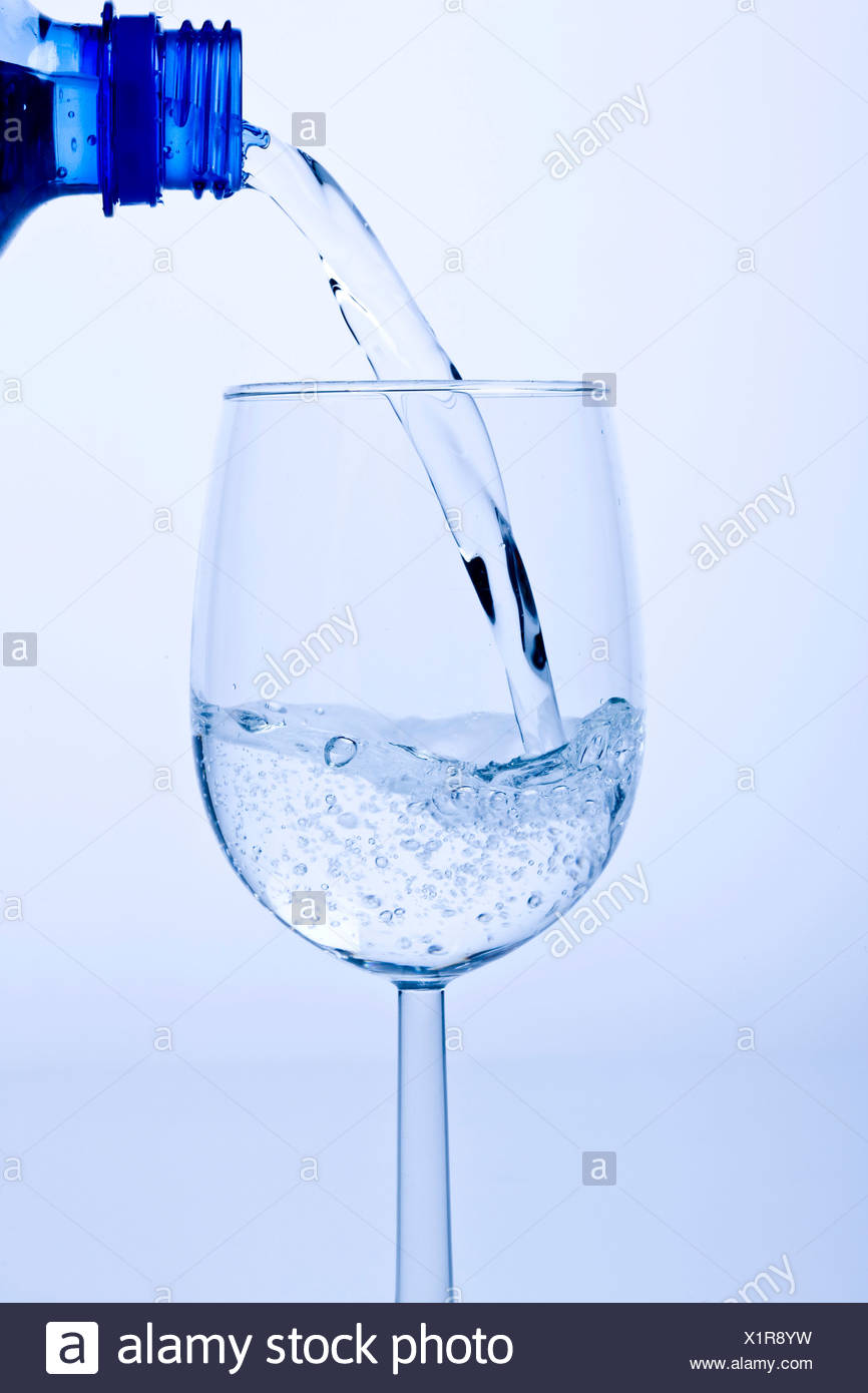 Pouring fresh water into a glass Stock Photo