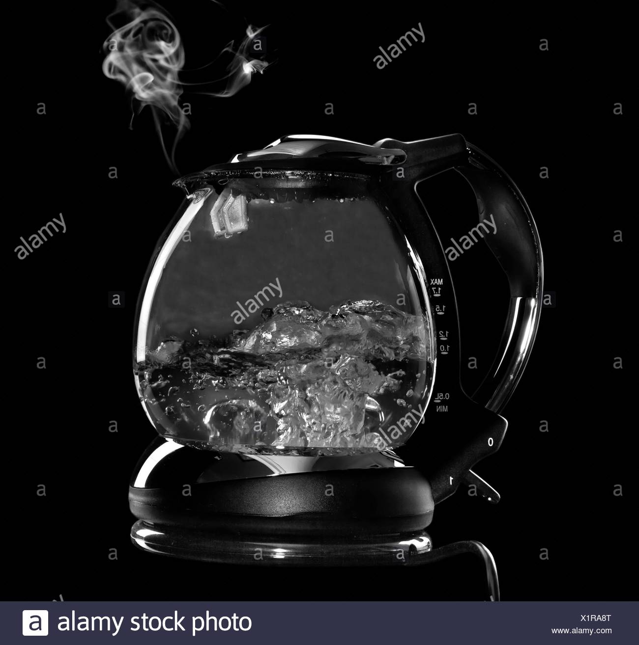 Kettle with boiling water and steam isolated with clipping path - Stock Image