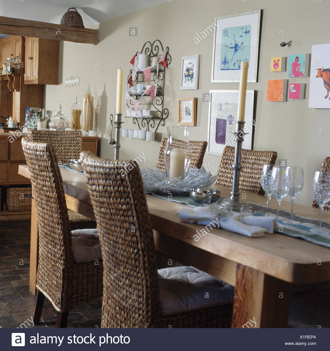 Banana Leaf Chairs And Oak Tables In Country Dining Room