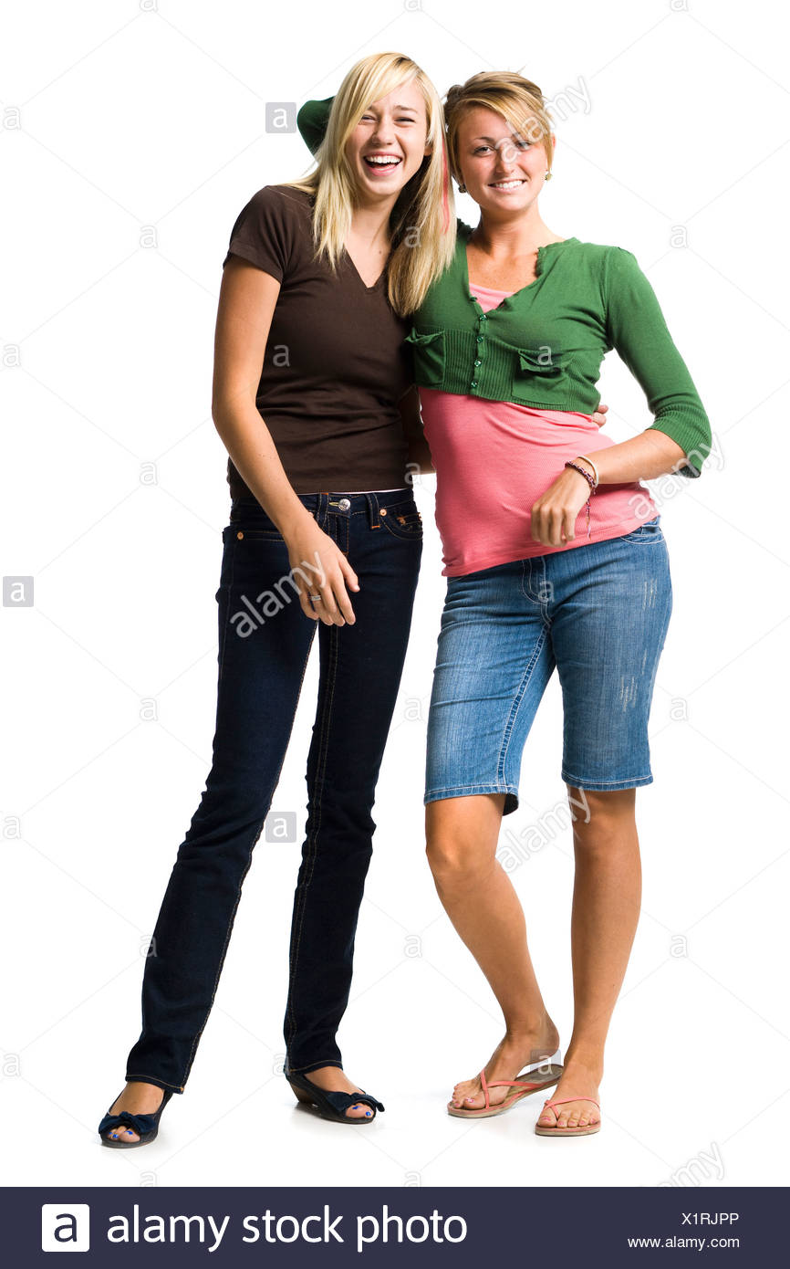 Two teenage girls laughing and embracing - Stock Image