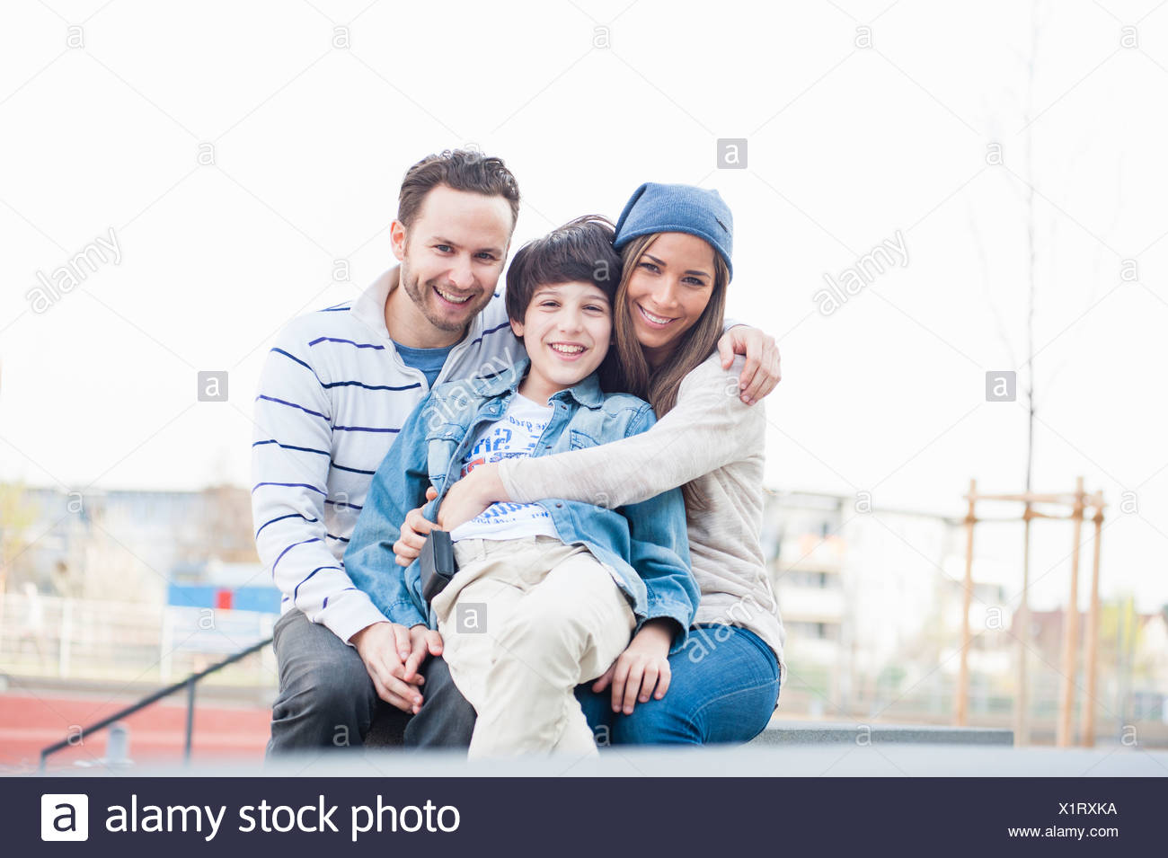 Portrait of family with one son - Stock Image