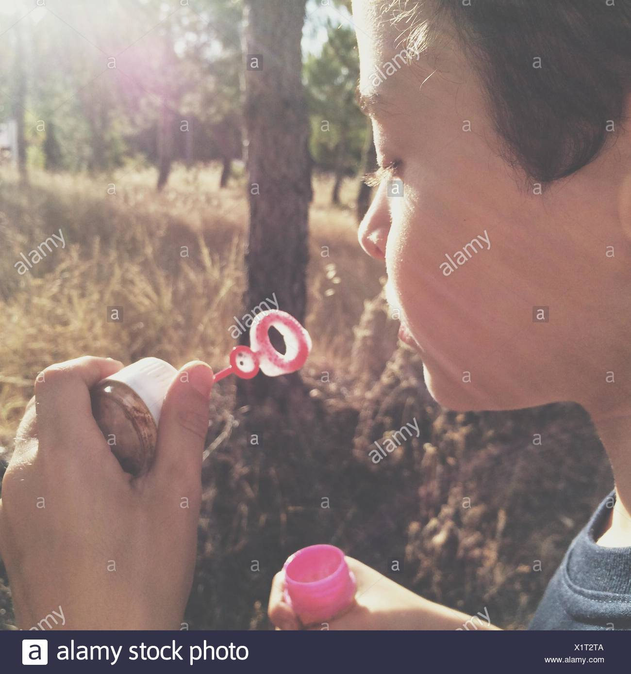 Kid Blowing Bubbles - Stock Image
