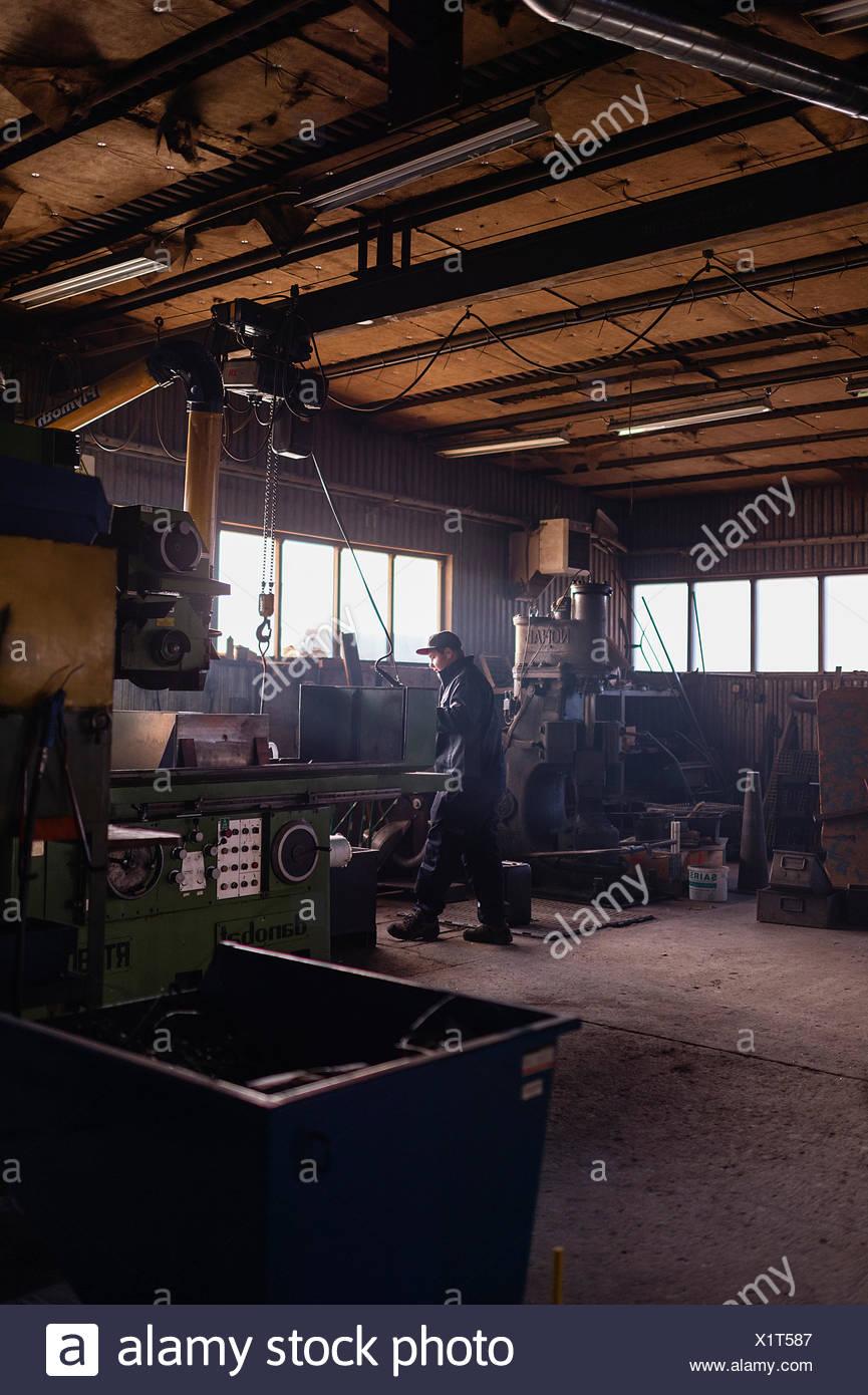 Sweden, Teenage boy (16-17) working in workshop - Stock Image