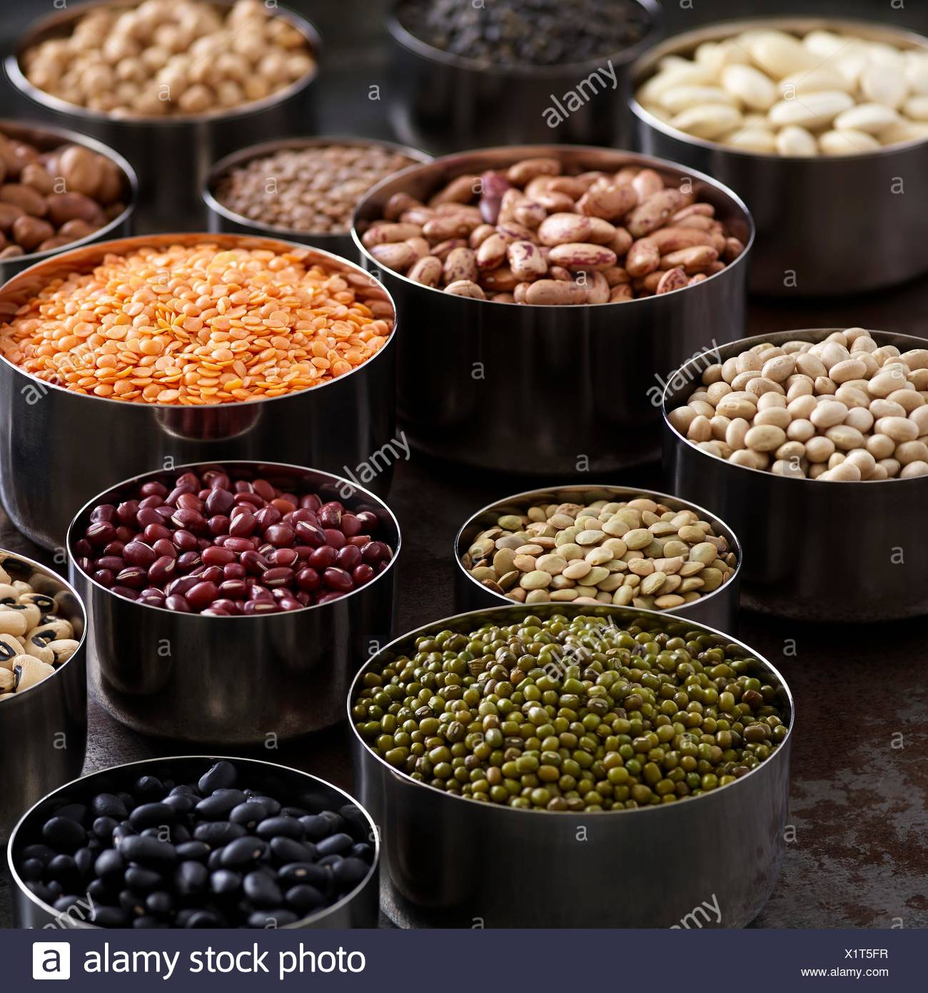 Pulses in metal bowls. - Stock Image