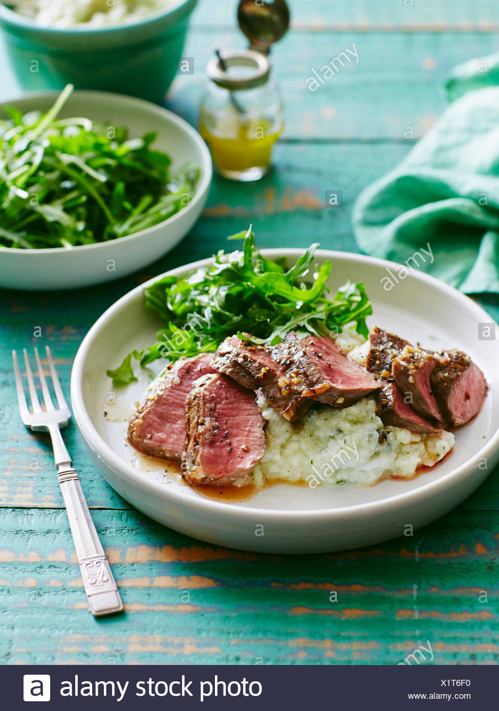 Plate of lamb with cauliflower, pear and mint mash - Stock Image