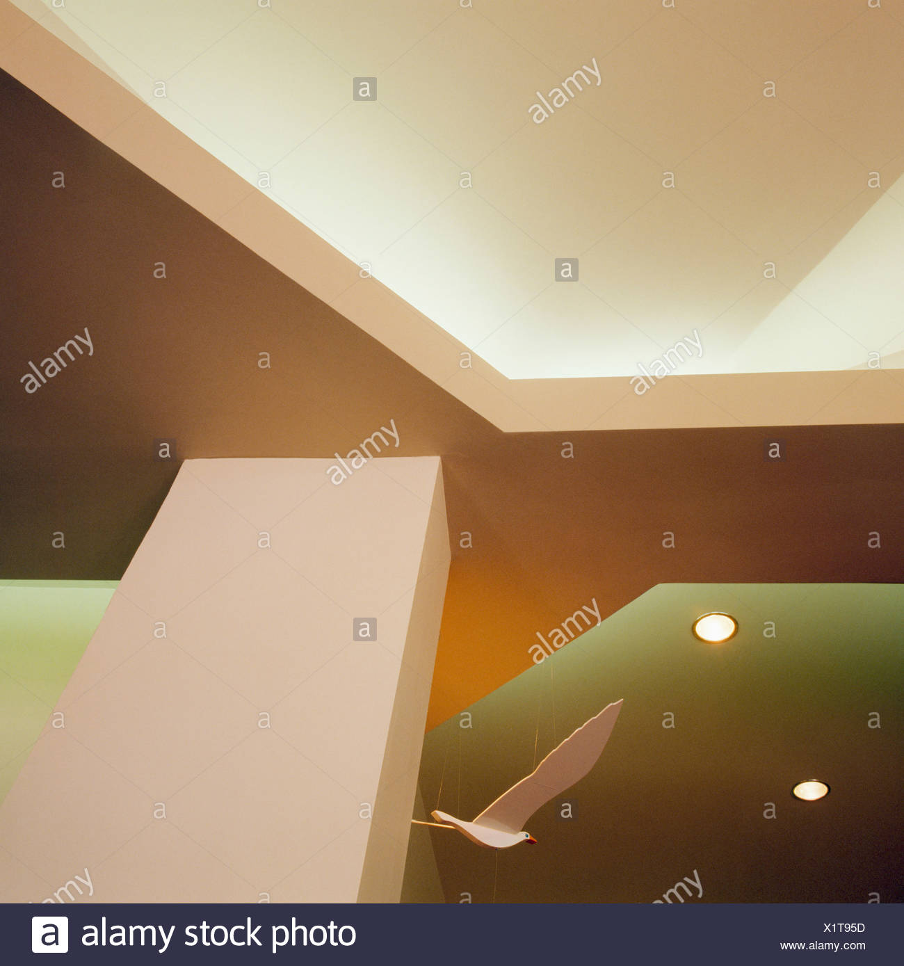 Upward view of ceiling of modern hall with recessed lighting - Stock Image