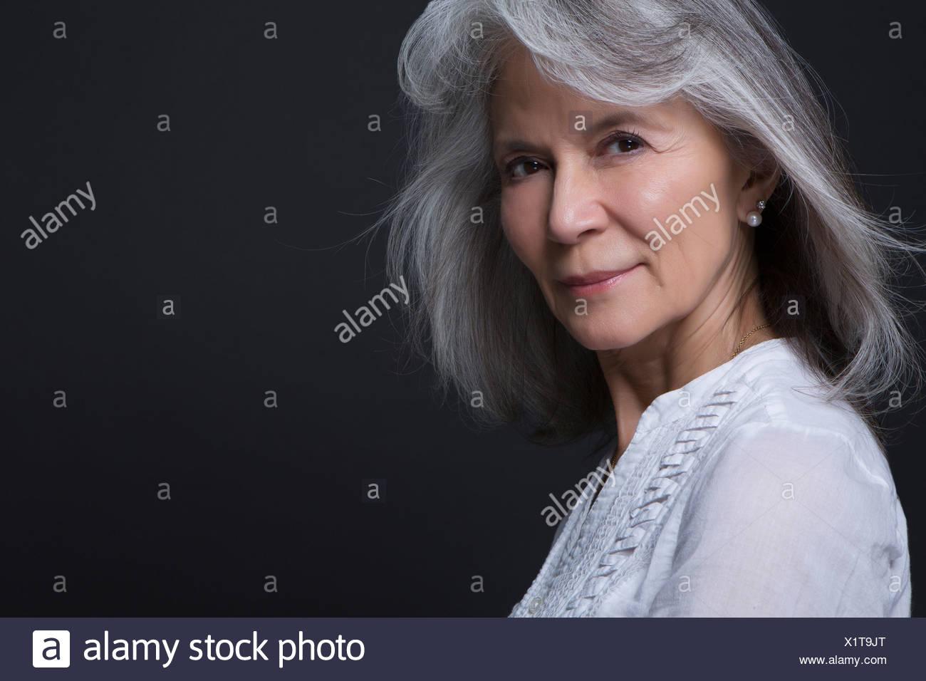 Studio portrait of beautiful senior woman - Stock Image
