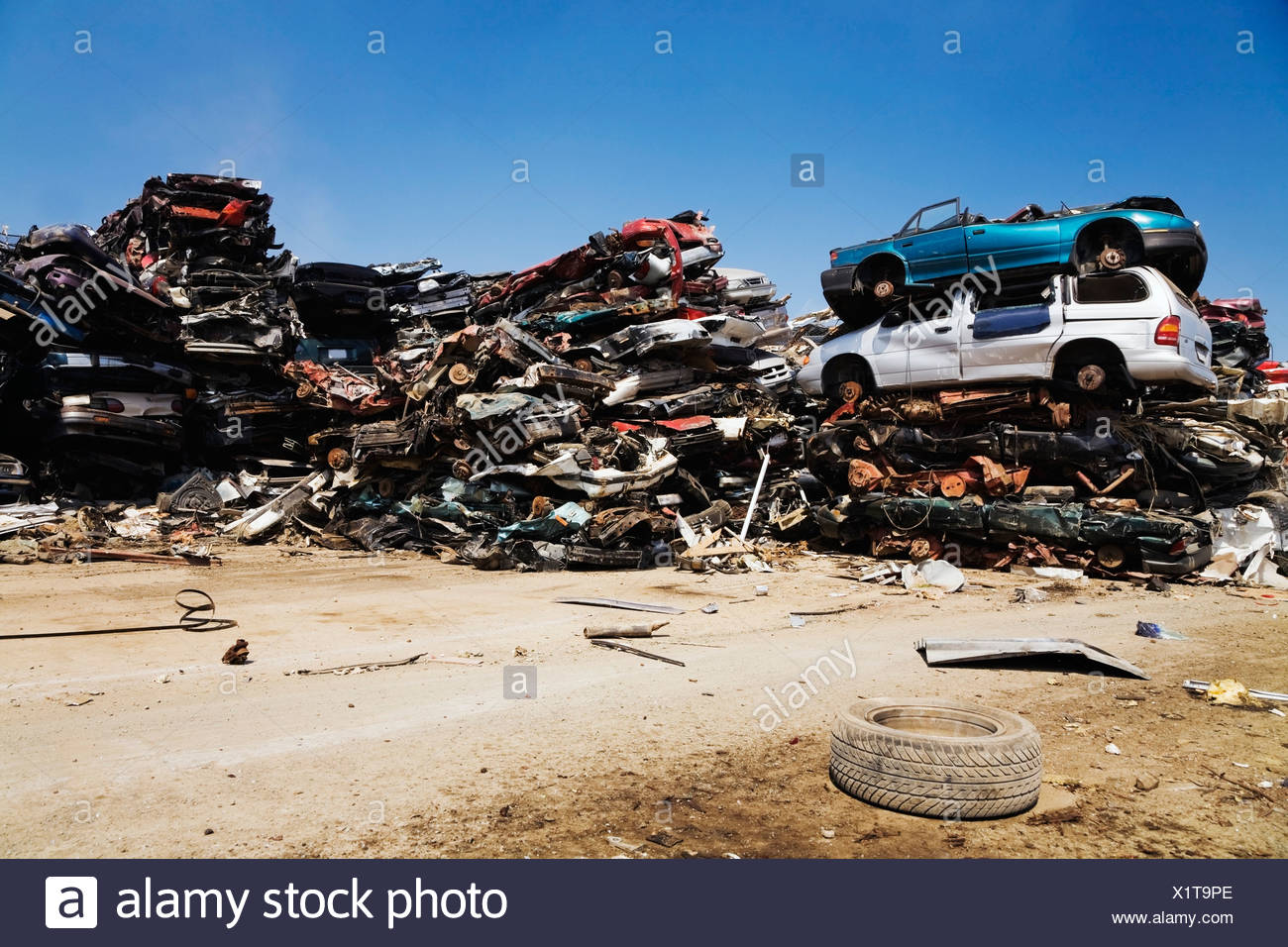 Quebec, Canada; Stacked And Crushed Automobiles At A Scrap Metal Recycling Yard - Stock Image