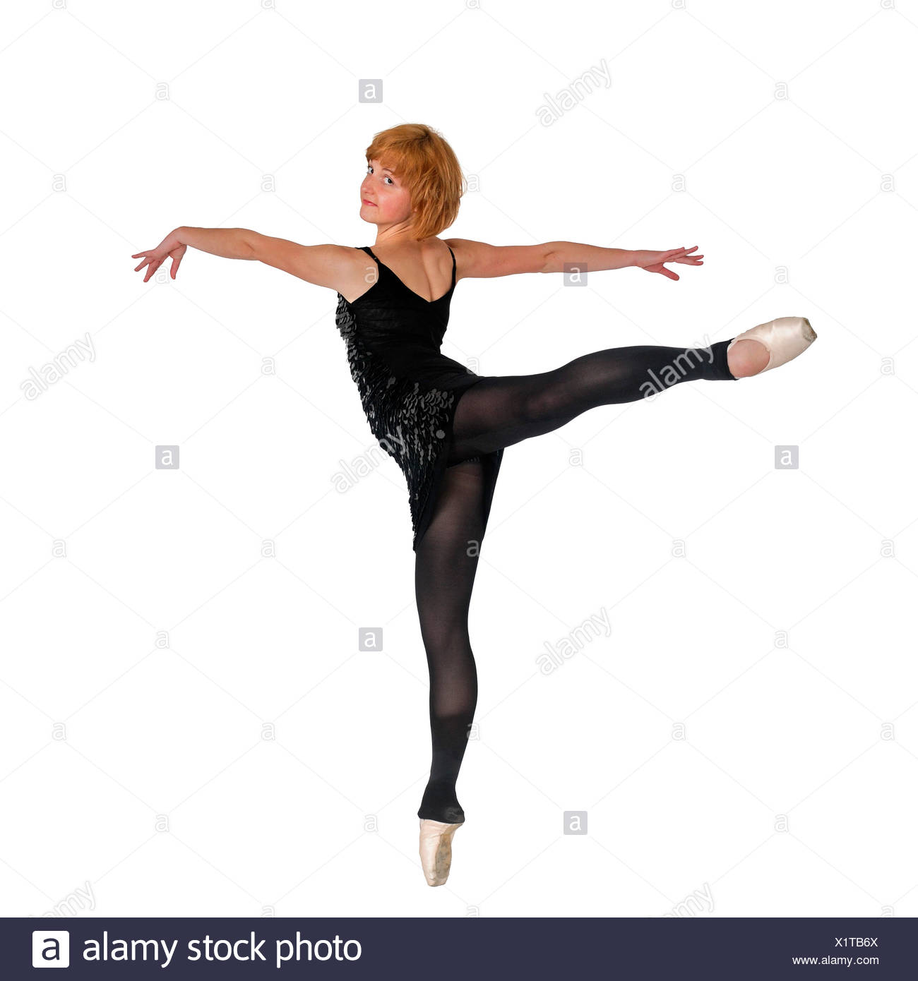 Female Ballet Dancer balances on her tows On white Background - Stock Image